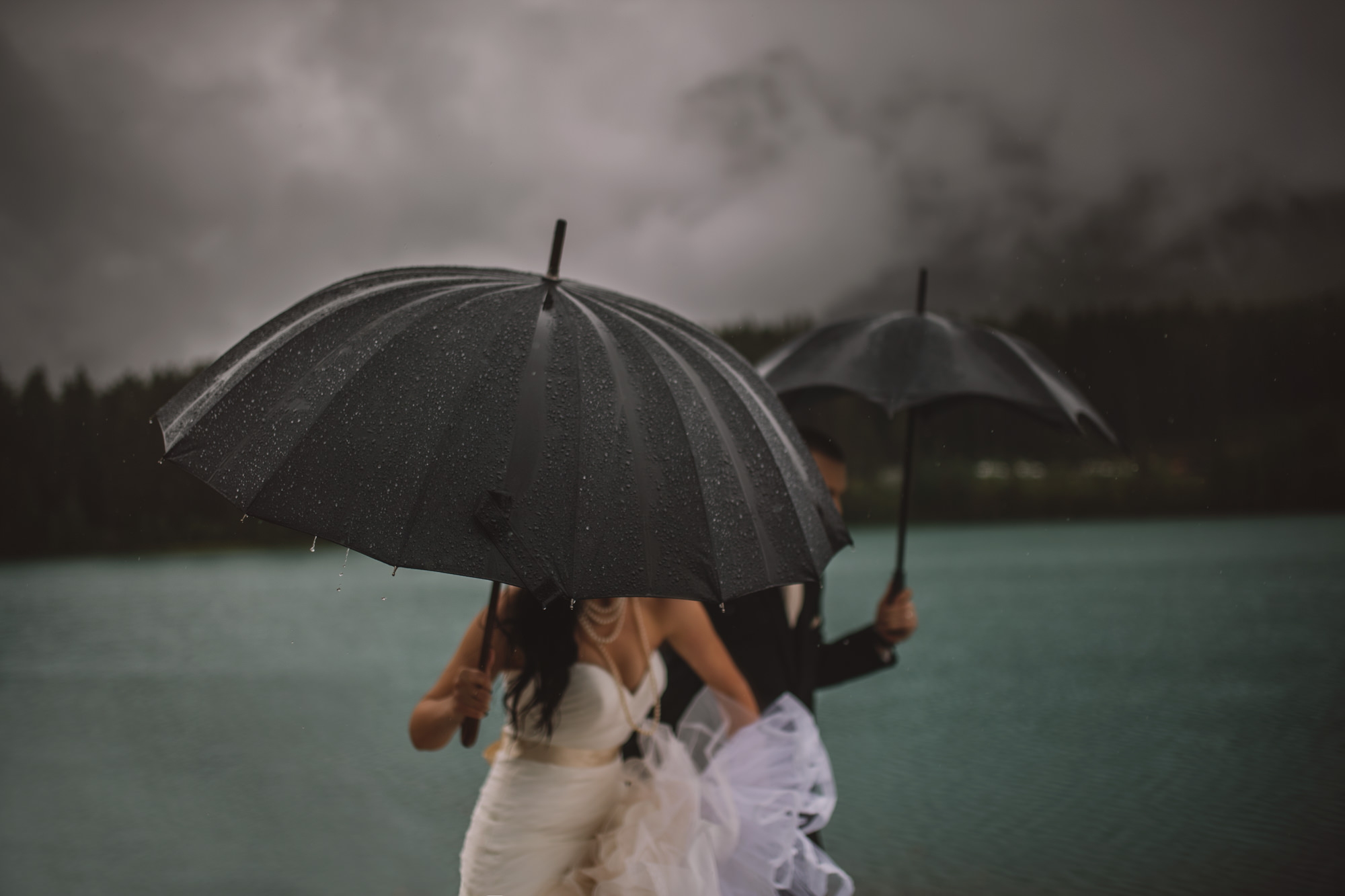Bride and groom on the run from rain - photo by McClintock Photography Agency
