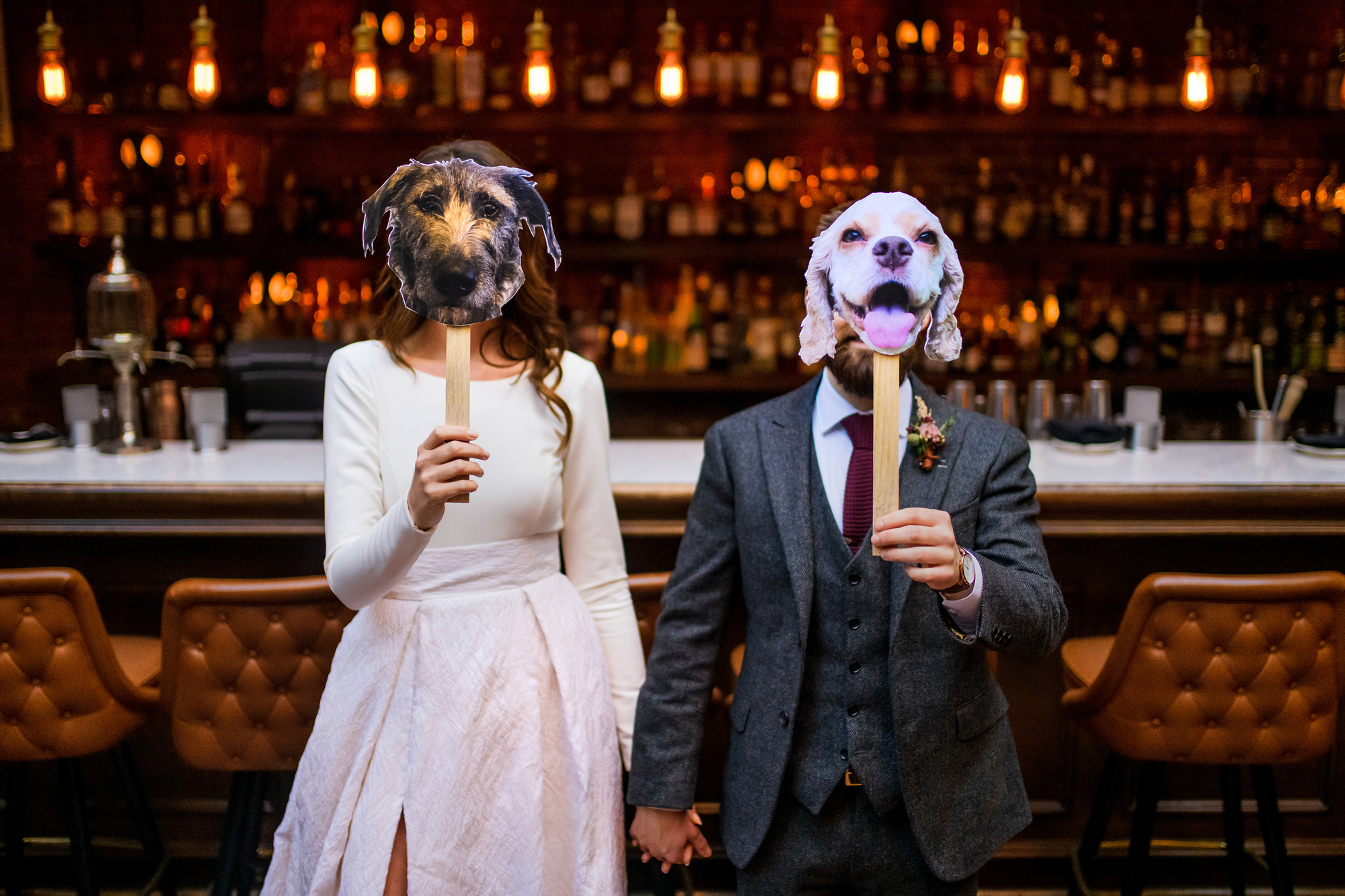 Bride and groom with doggie masks - photo by Cooked Photography