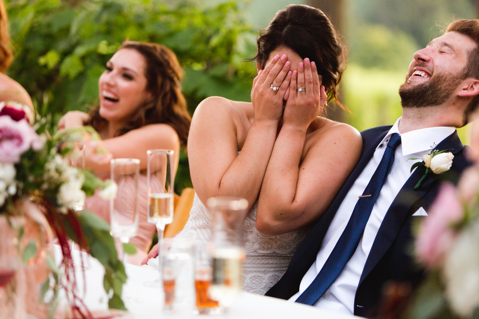 Bride hides her face in hands laughing - Jessica Hill Photography