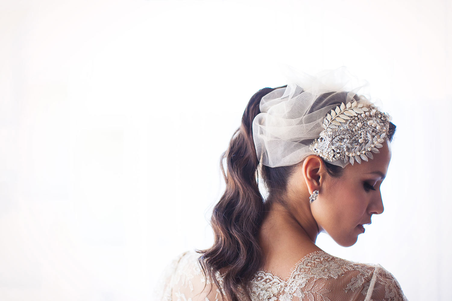 Bride in jeweled fascinator and lace top, by Callaway Gable