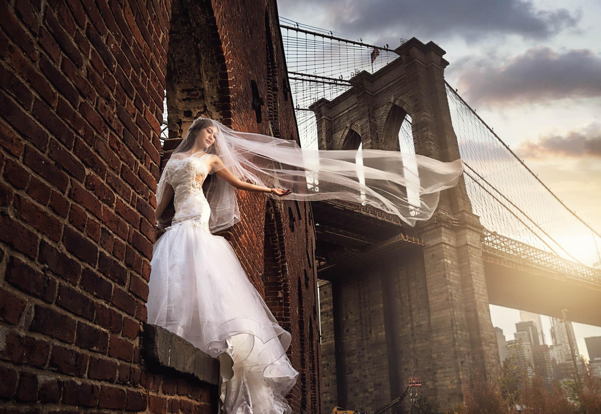 Bride with flowing veil near Brooklyn Bridge by CM Leung
