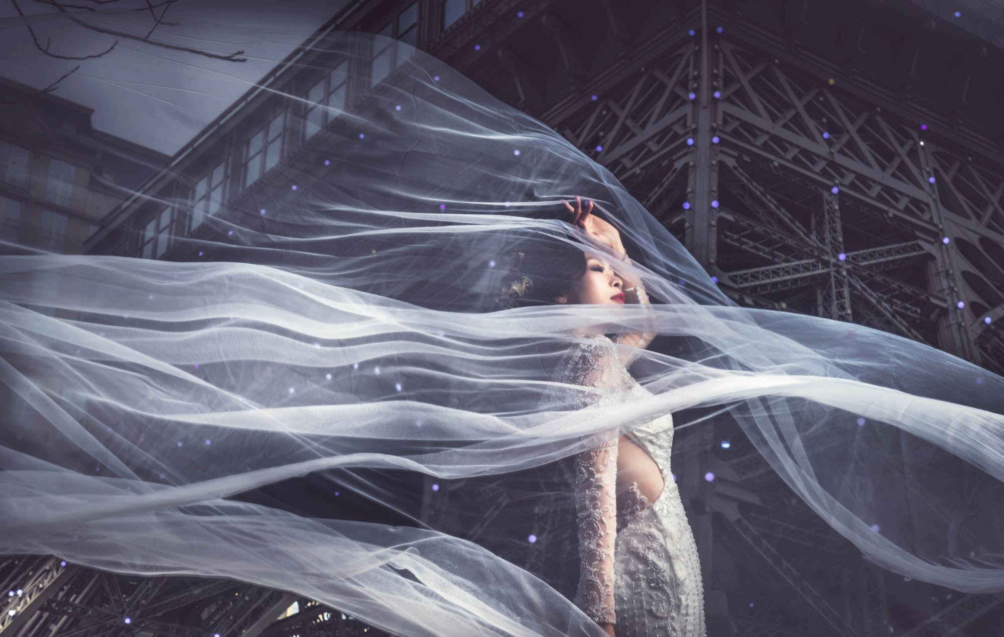 Bride with flowing veil in surreal shot, by CM Leung