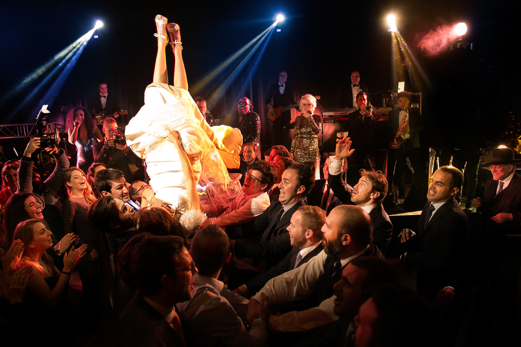 Funny photo of bride upside down on dance floor by David Bastianoni