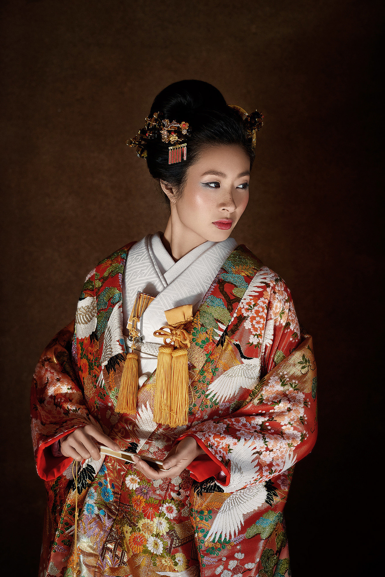 Bride in red and gold traditional kimono - photo by 37 Frames - Japan