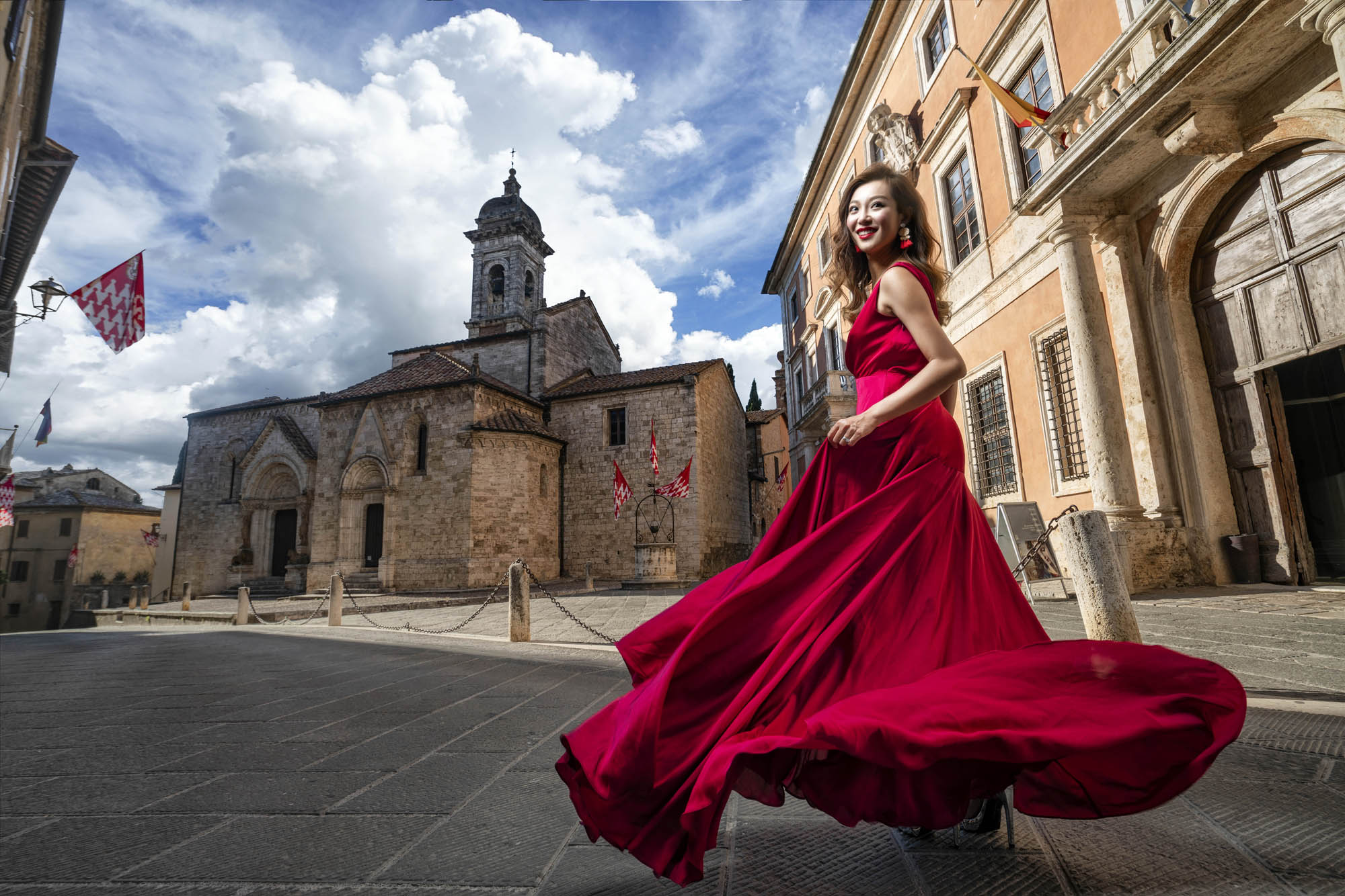 Bride in red gown swirling in historic city, by CM Leung