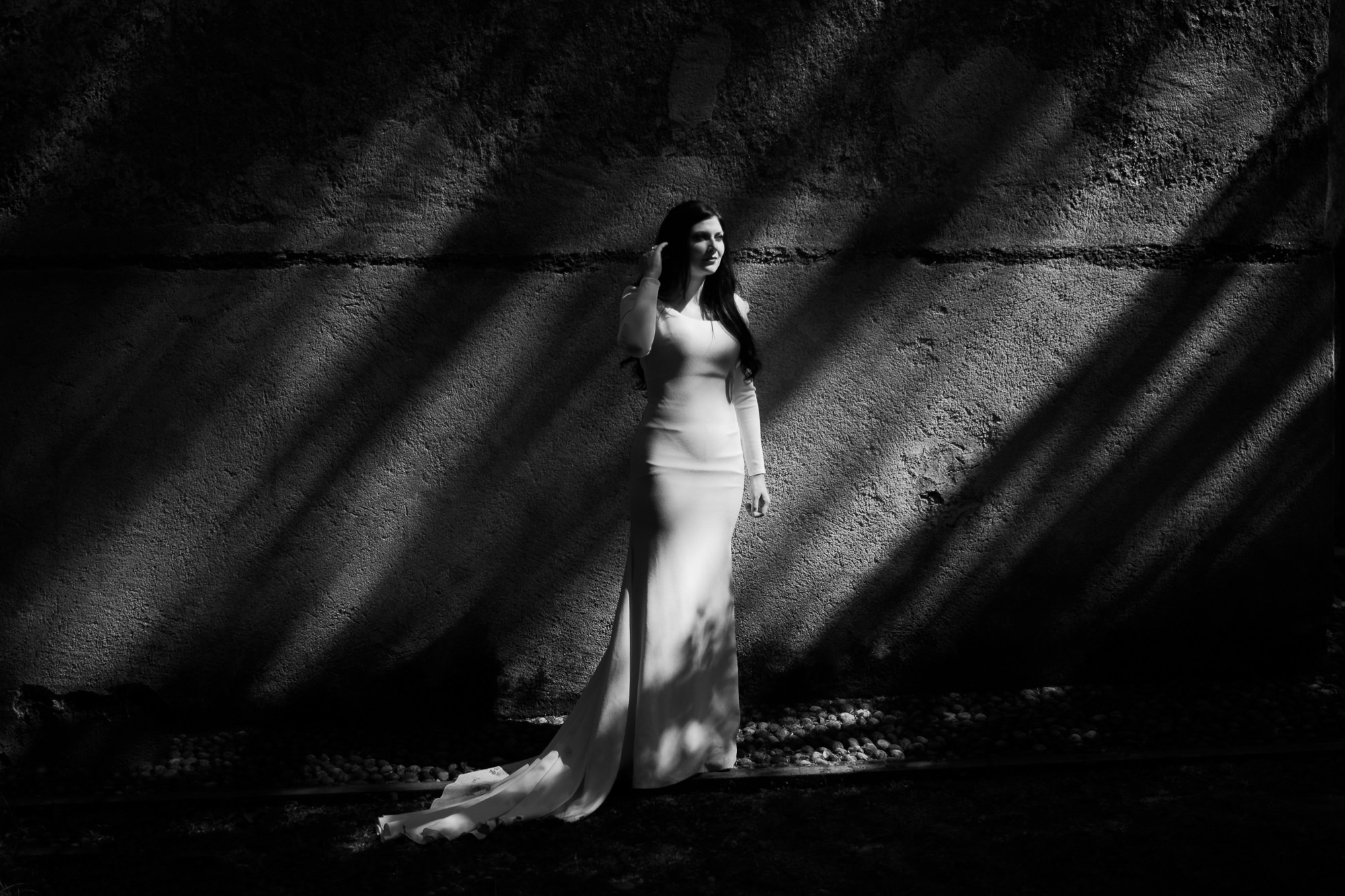 Bride in round neck long silk sheath photo by Nordica Photography