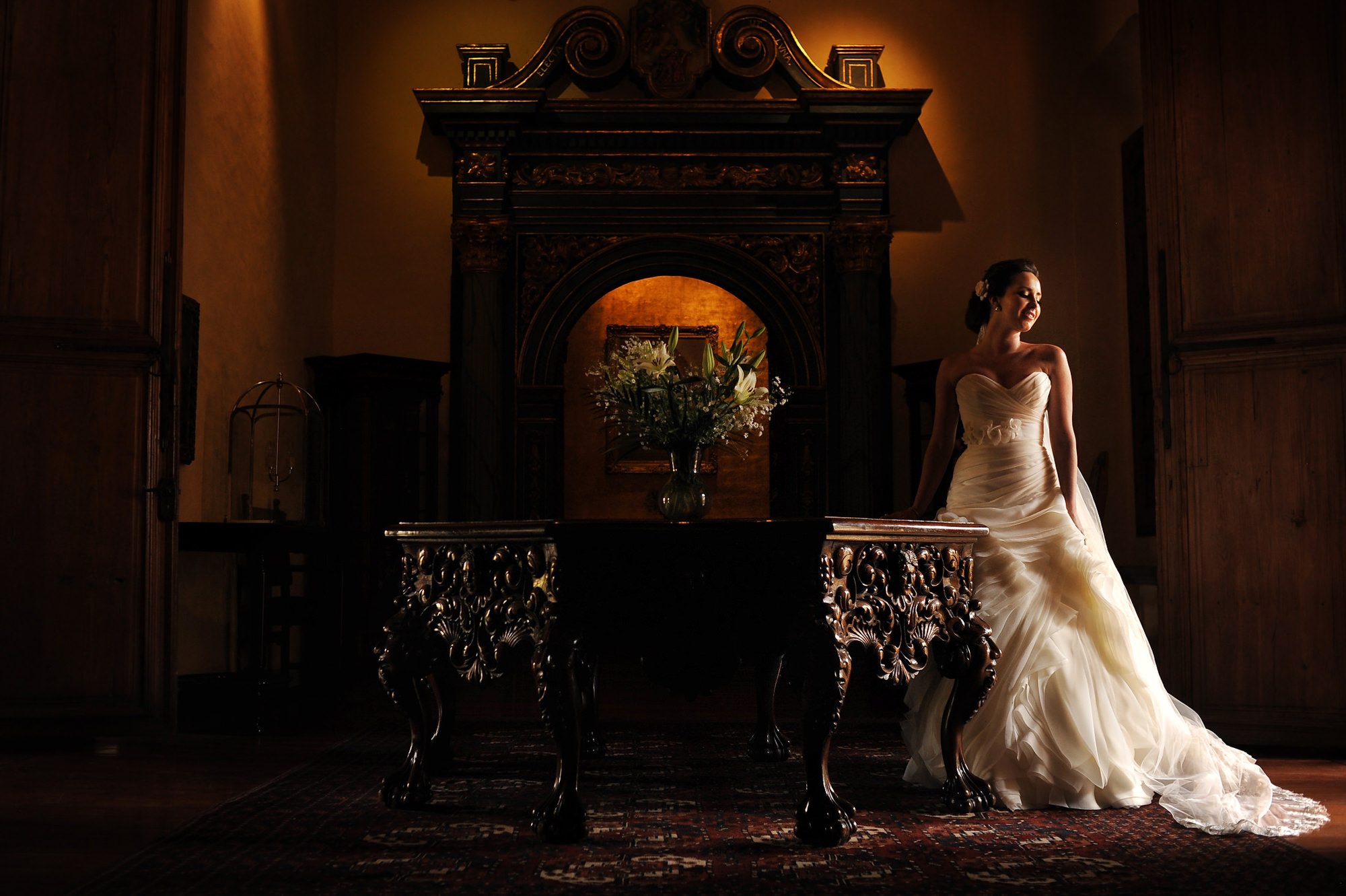 Bride in chiffon strapless ruffled gown in historic hotel - Daniel Aguilar Photographer