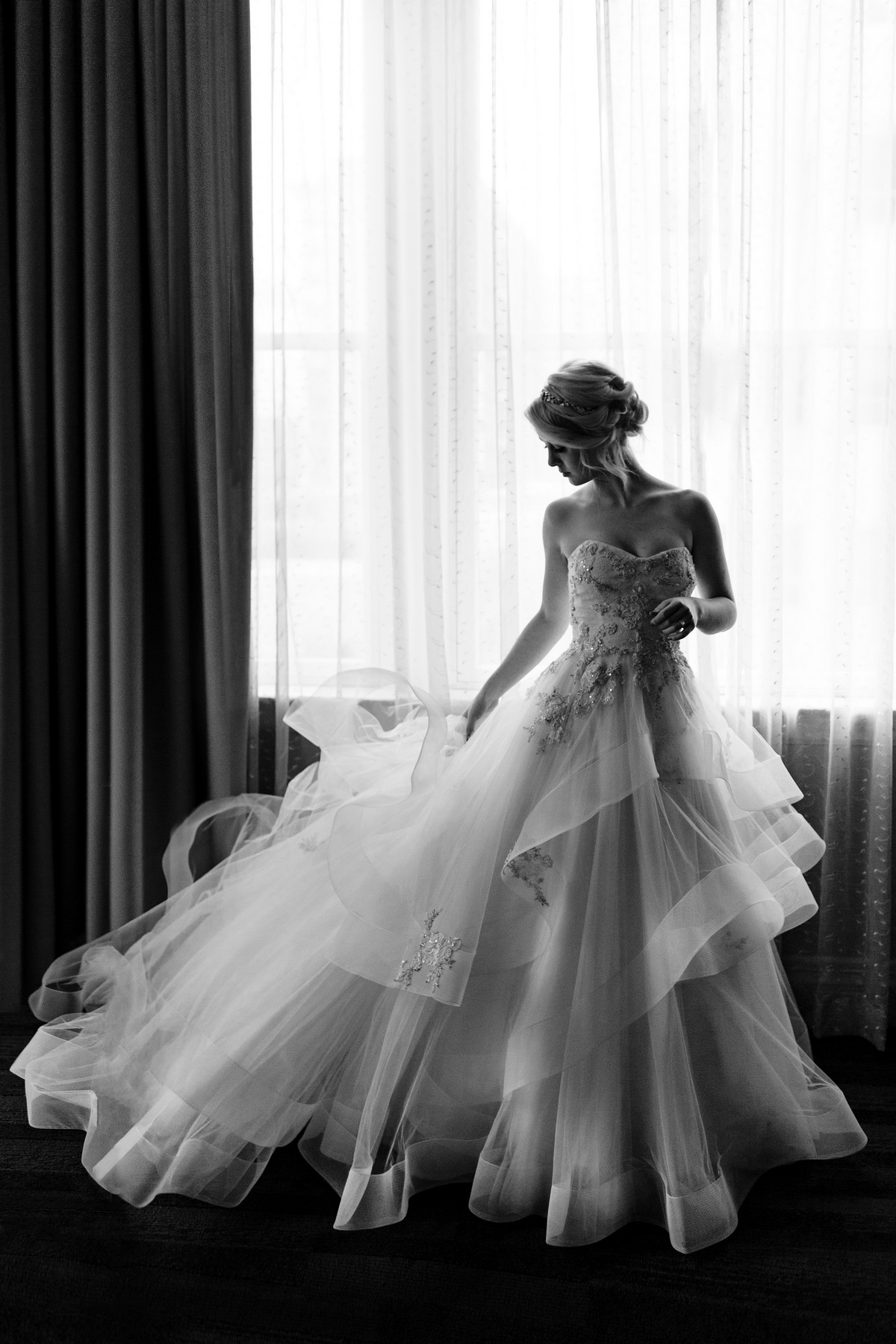 Bride in stunning strapless ruffled ballgown photo by John and Joseph - Los Angeles