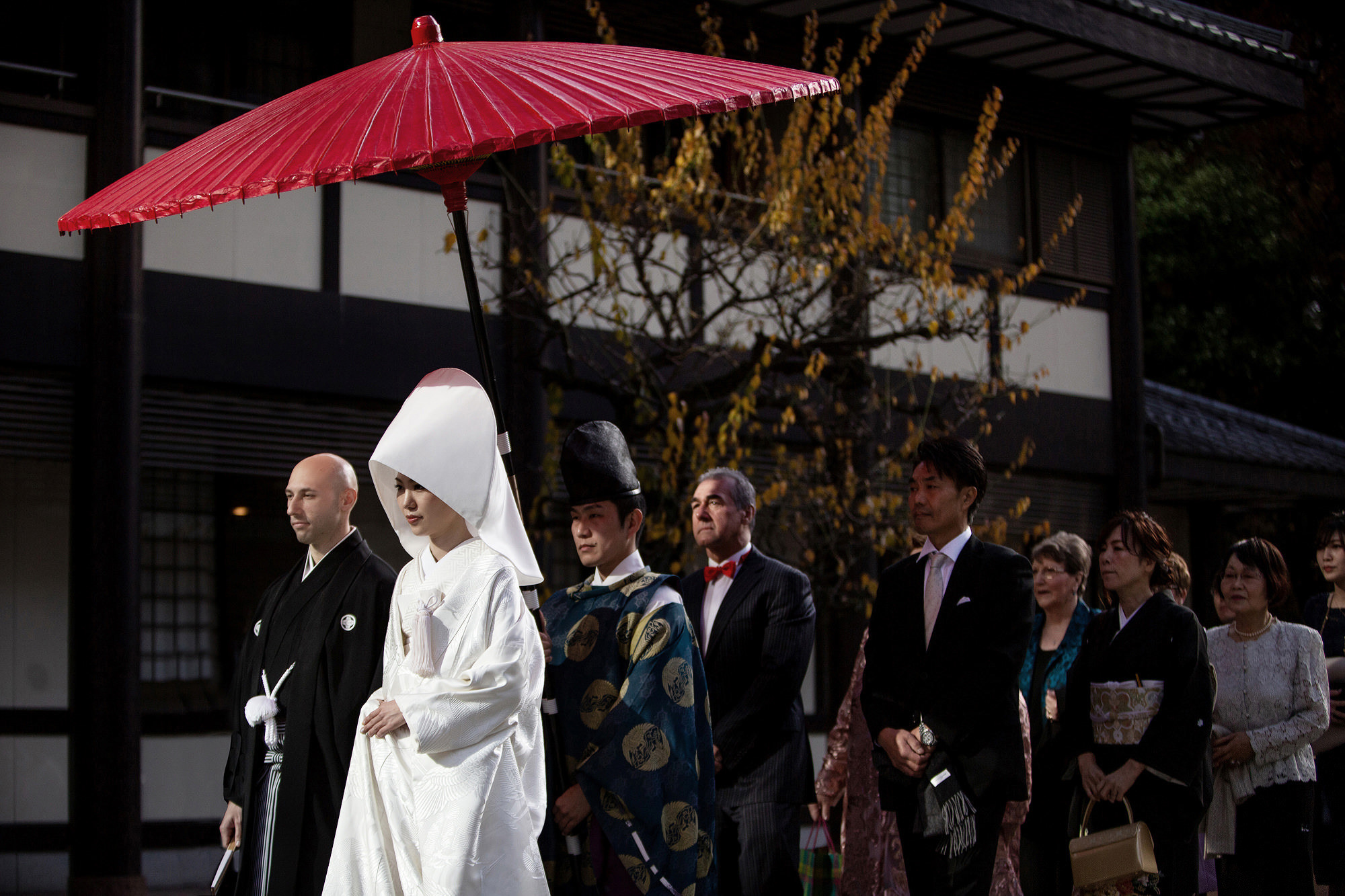 Traditional Japanese bridal party walking to ceremony - photo by 37 Frames