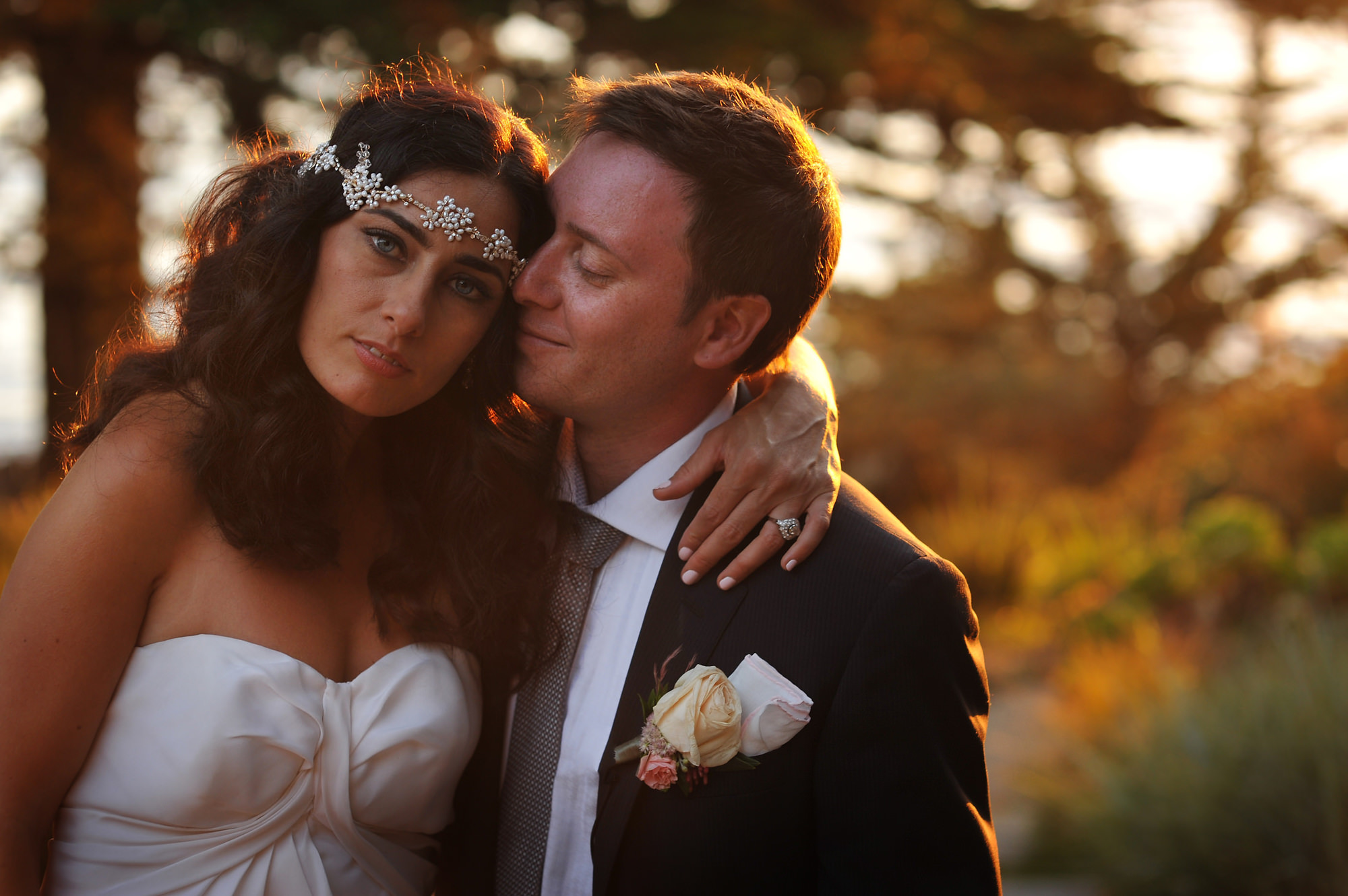 Bride in jeweled crown with happy groom golden hour - photo by Daniel Aguilar