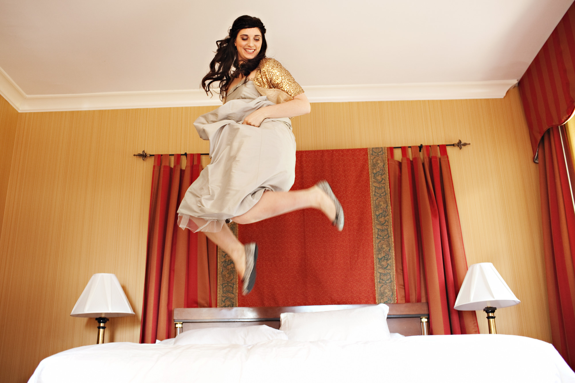 Bride jumping on bed - PhotoJJ