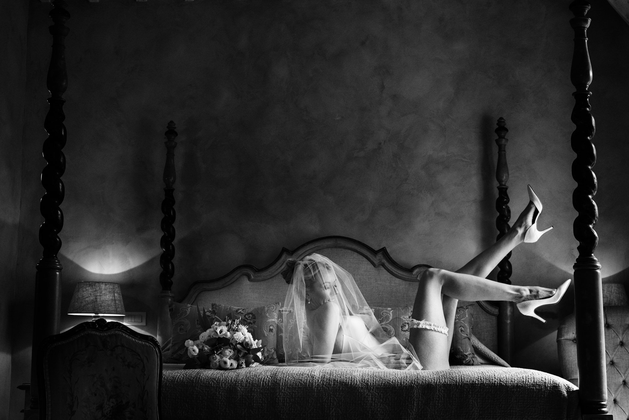 Boudoir bride kicking up high heels - photo by look-fotographica