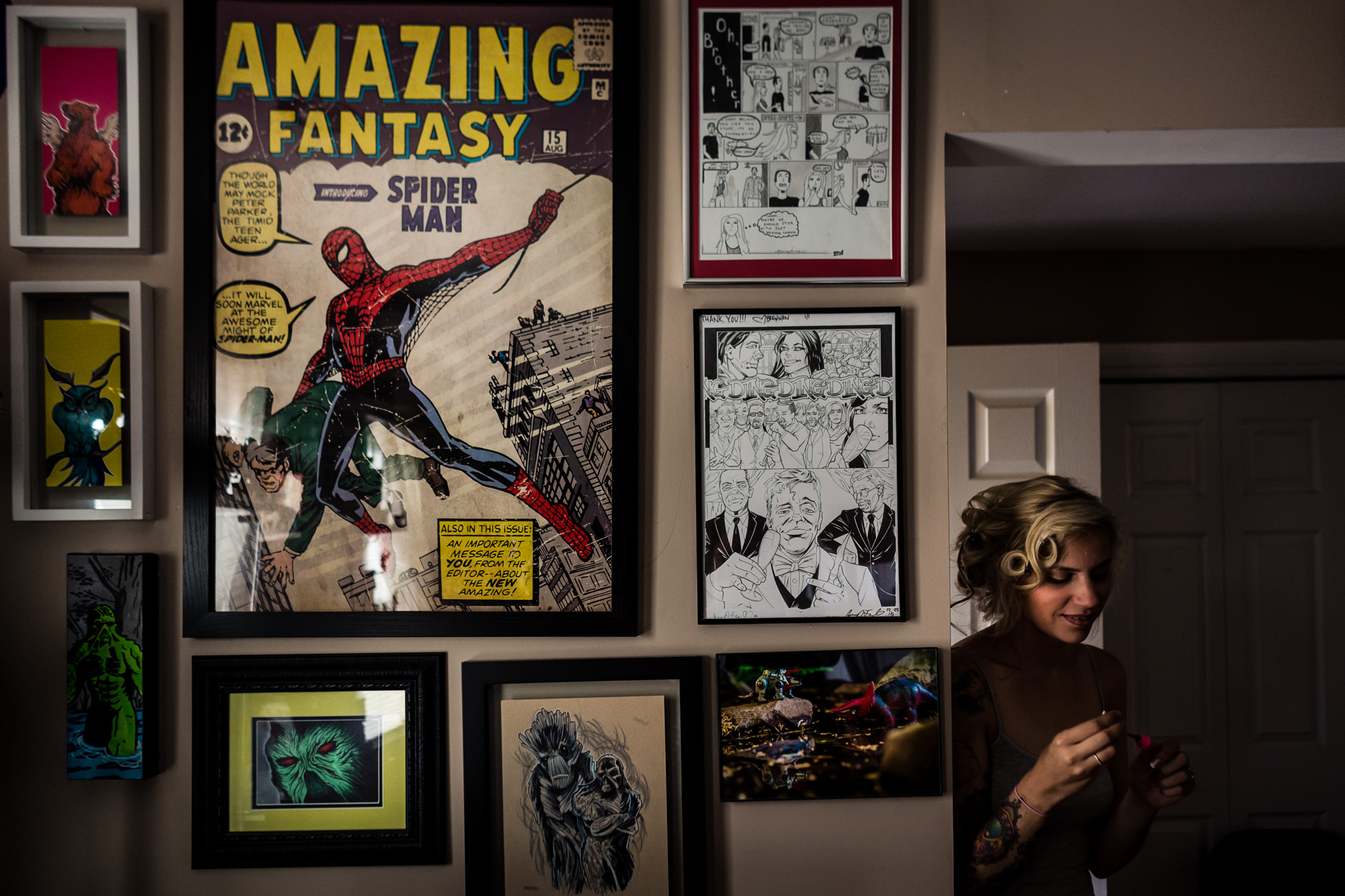Bride leaning on wall with spiderman poster - photo by JAG Studios