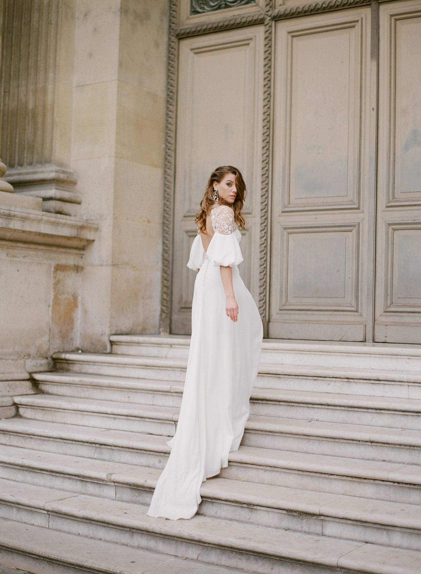 Bride on stairs of cathedral with ballon lace sleeves  - Gianluca Adovasio Photography