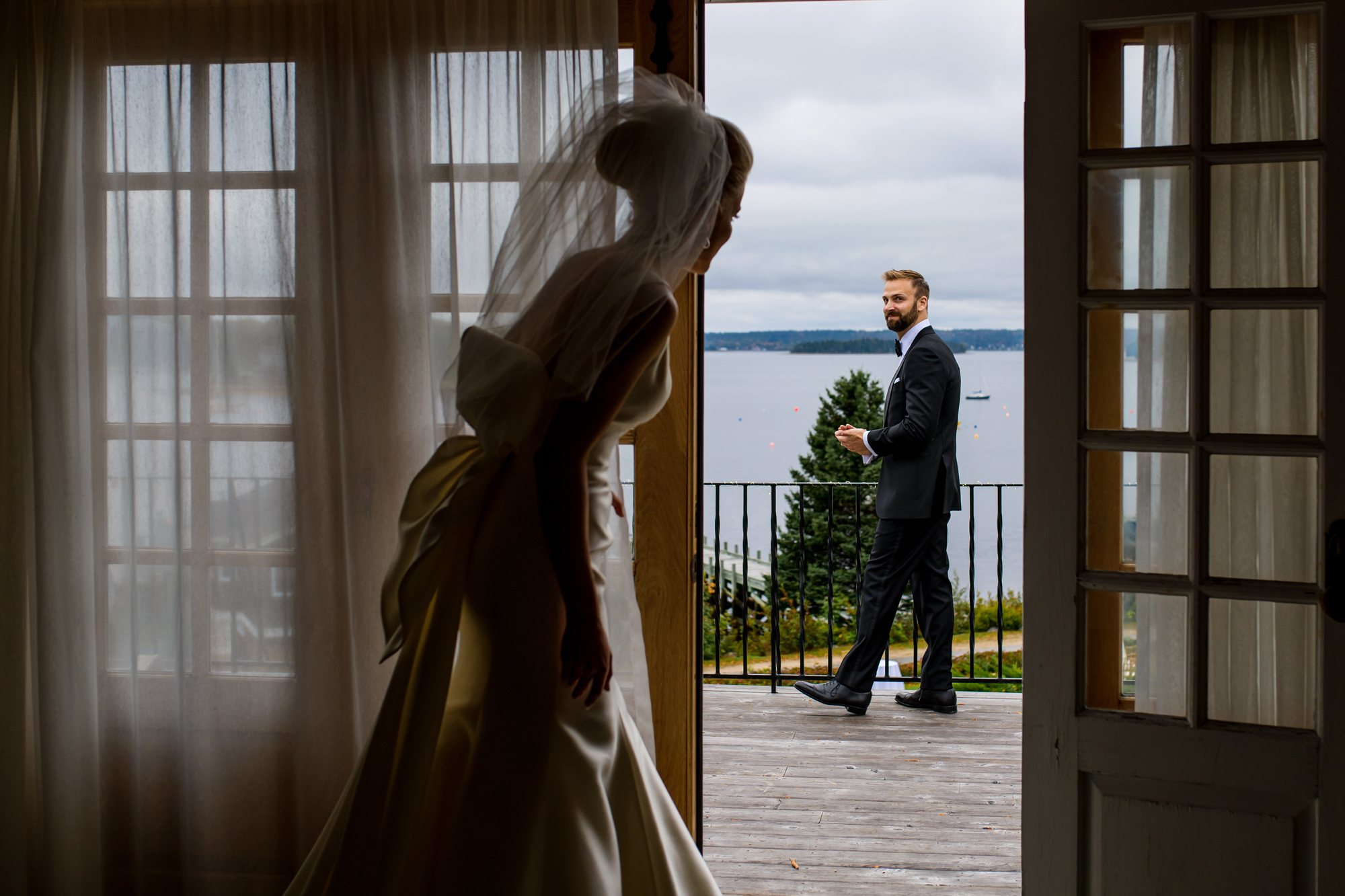 Bride peeks out at groom - photo by Cooked Photography