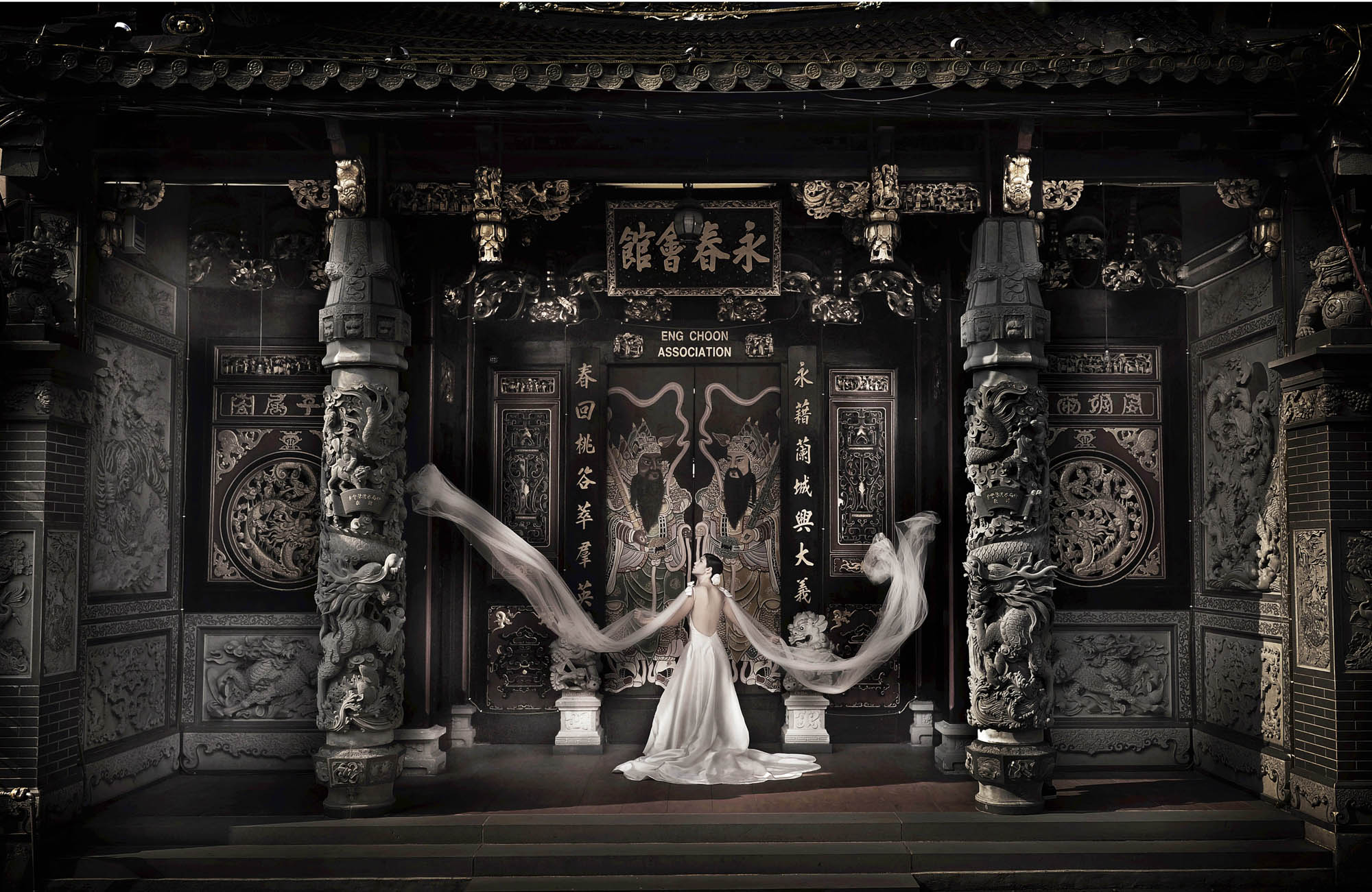 Bride in dramatic veil shot in front of Chinese temple, by CM Leung