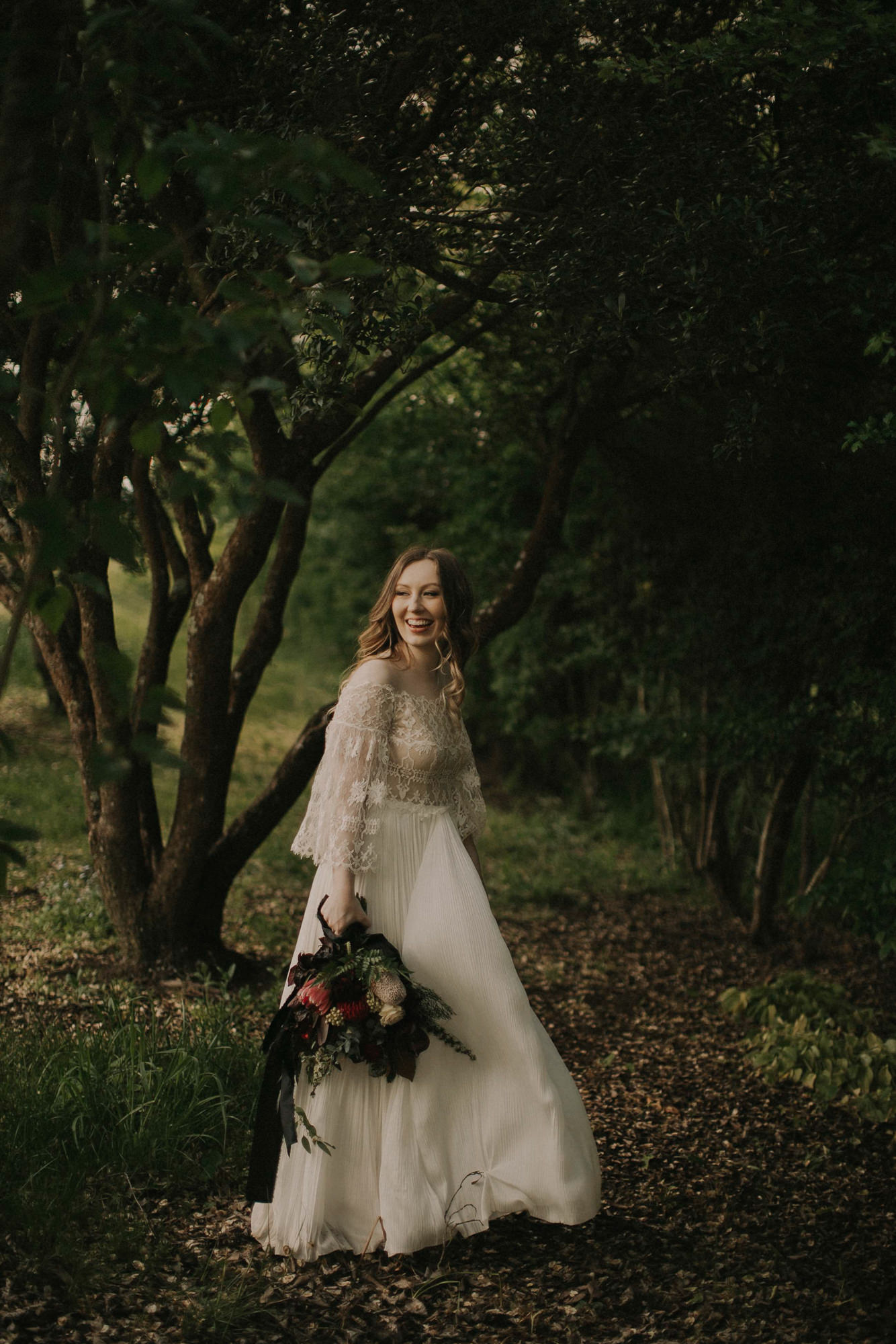Bride in vintage dress in woods - photo by Dan O'Day