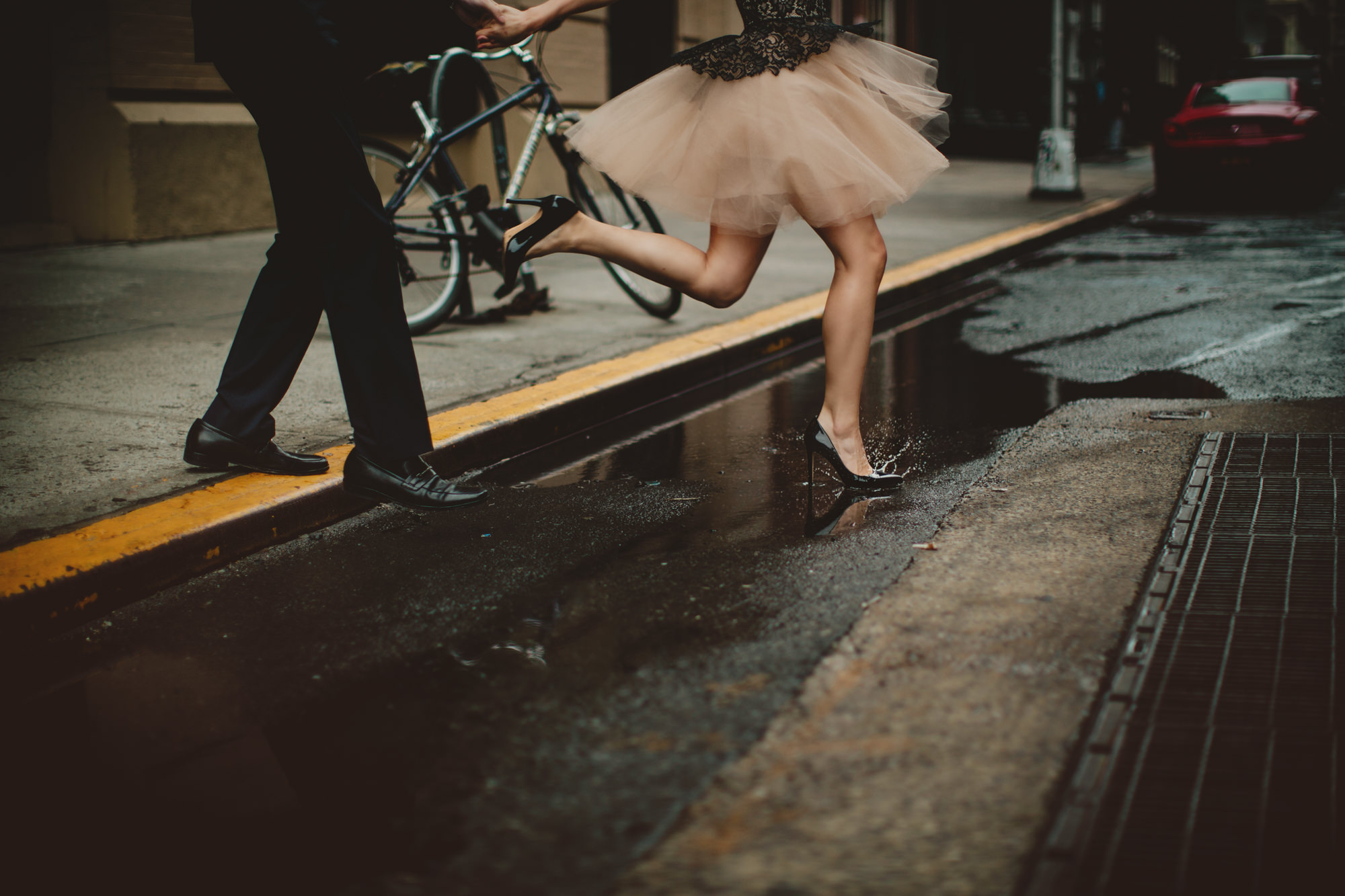 Bride steps into street wearing pumps and blush tulle miniskirt - photo by McClintock Photography Agency
