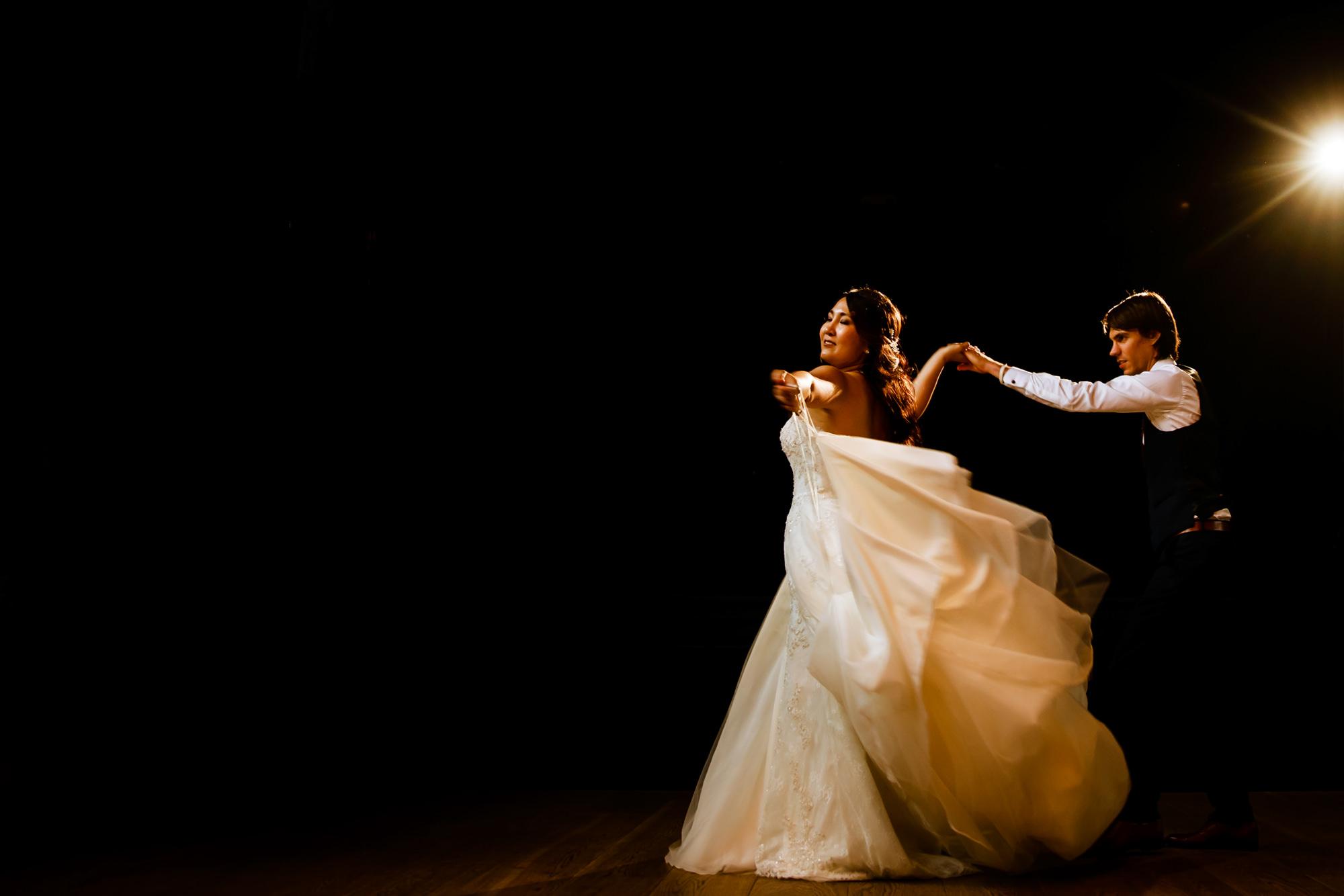 Bride leads groom to dance floor - photo by Philippe Swiggers