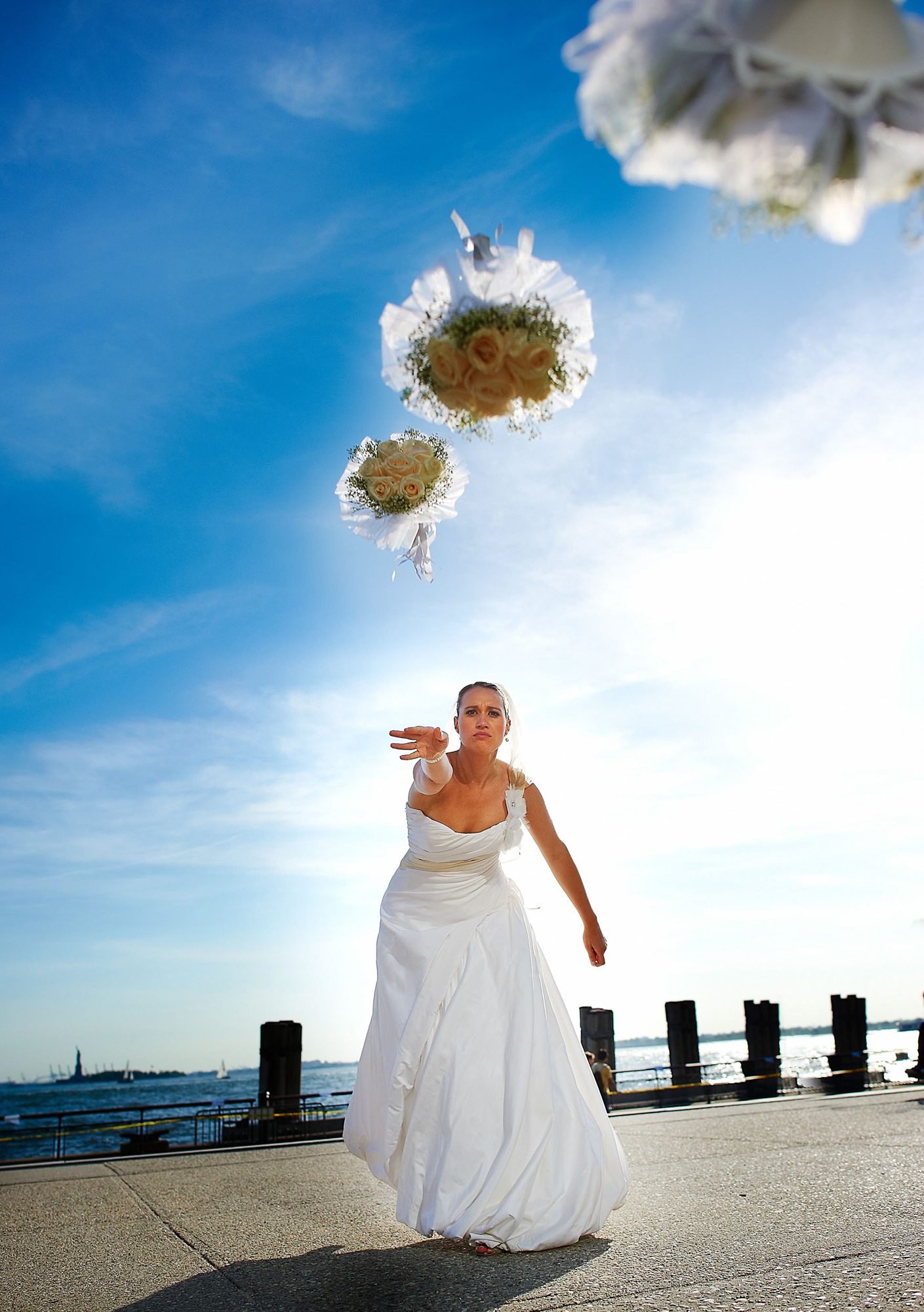 Creative composite of bride throwing bouquet at camera, photo by The Brenizers