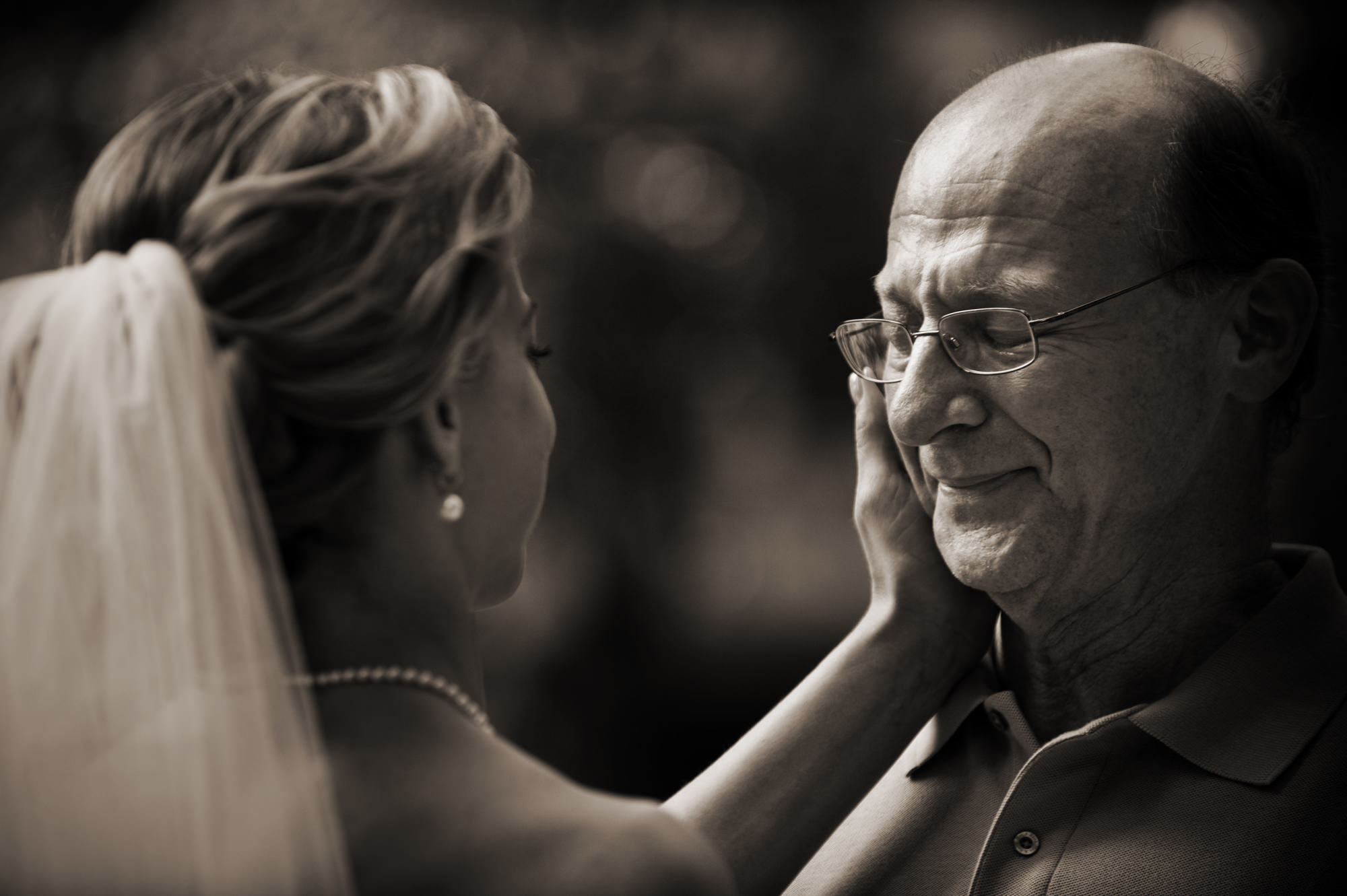 Bride touching elder's emotional face photo by Cliff Mautner
