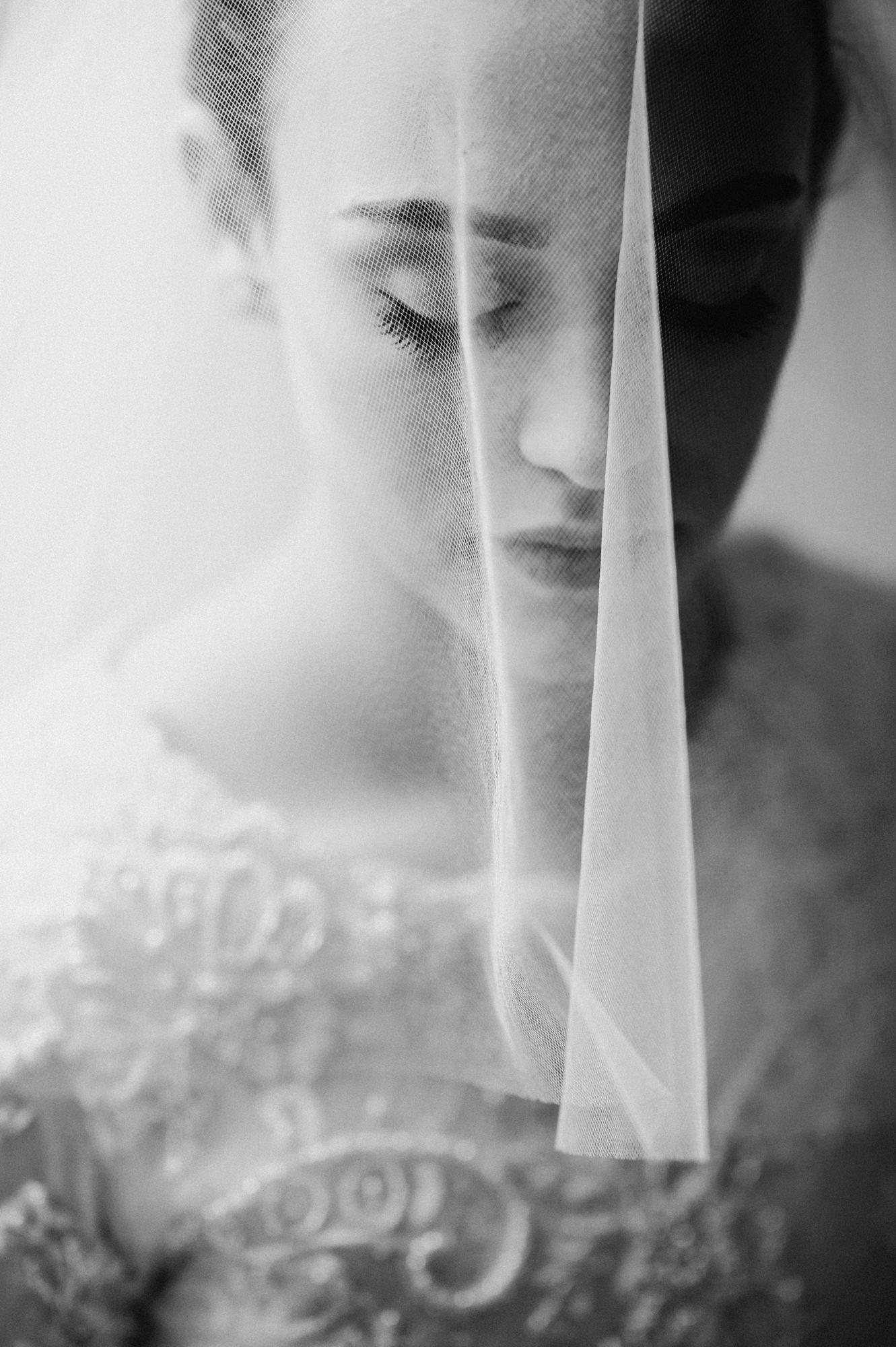 Bride under veil with round beaded neckline  - photo by Kristen Marie Parker