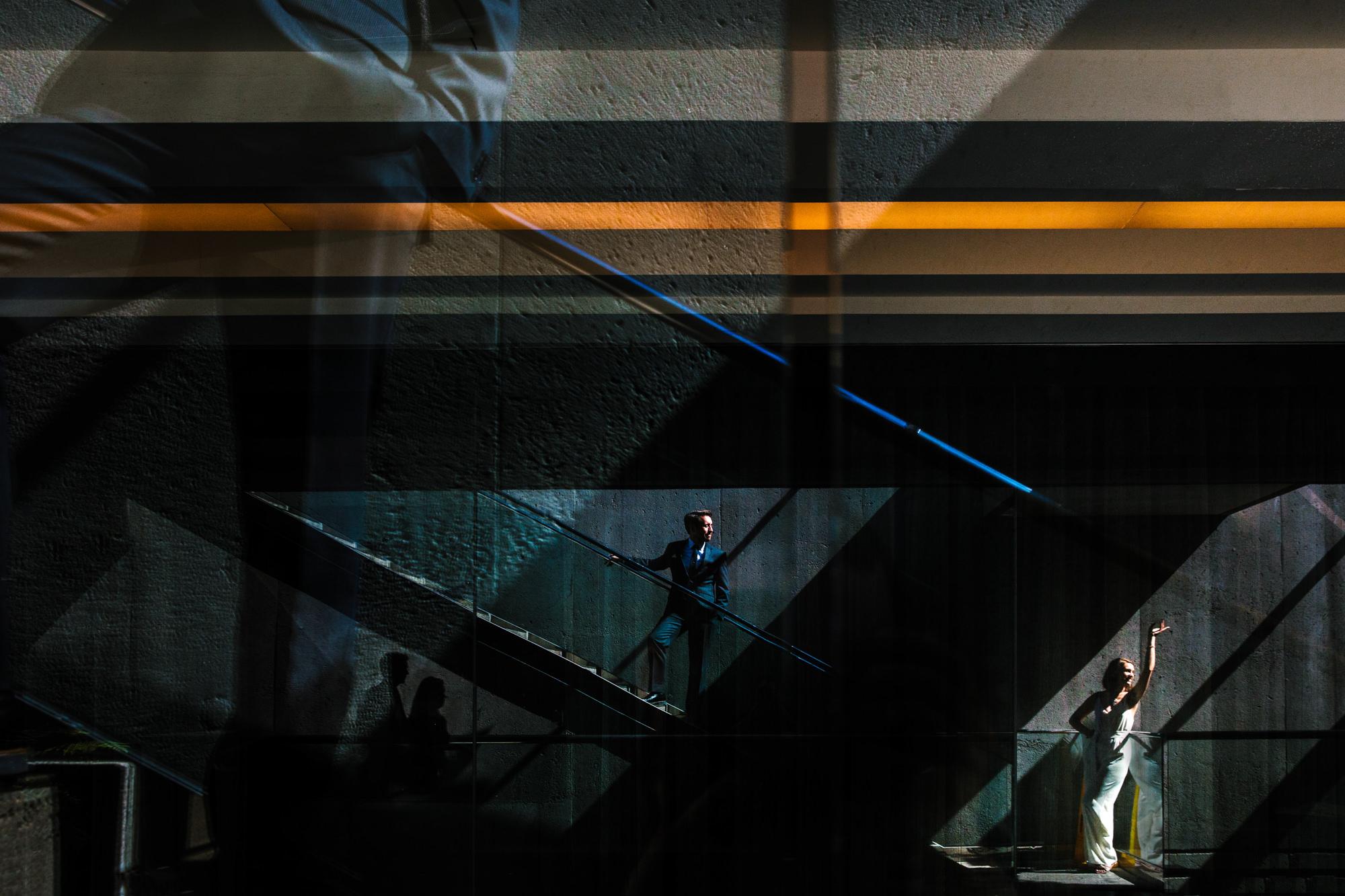 Bride waves goodbye at bottom of escalator Yves Schepers