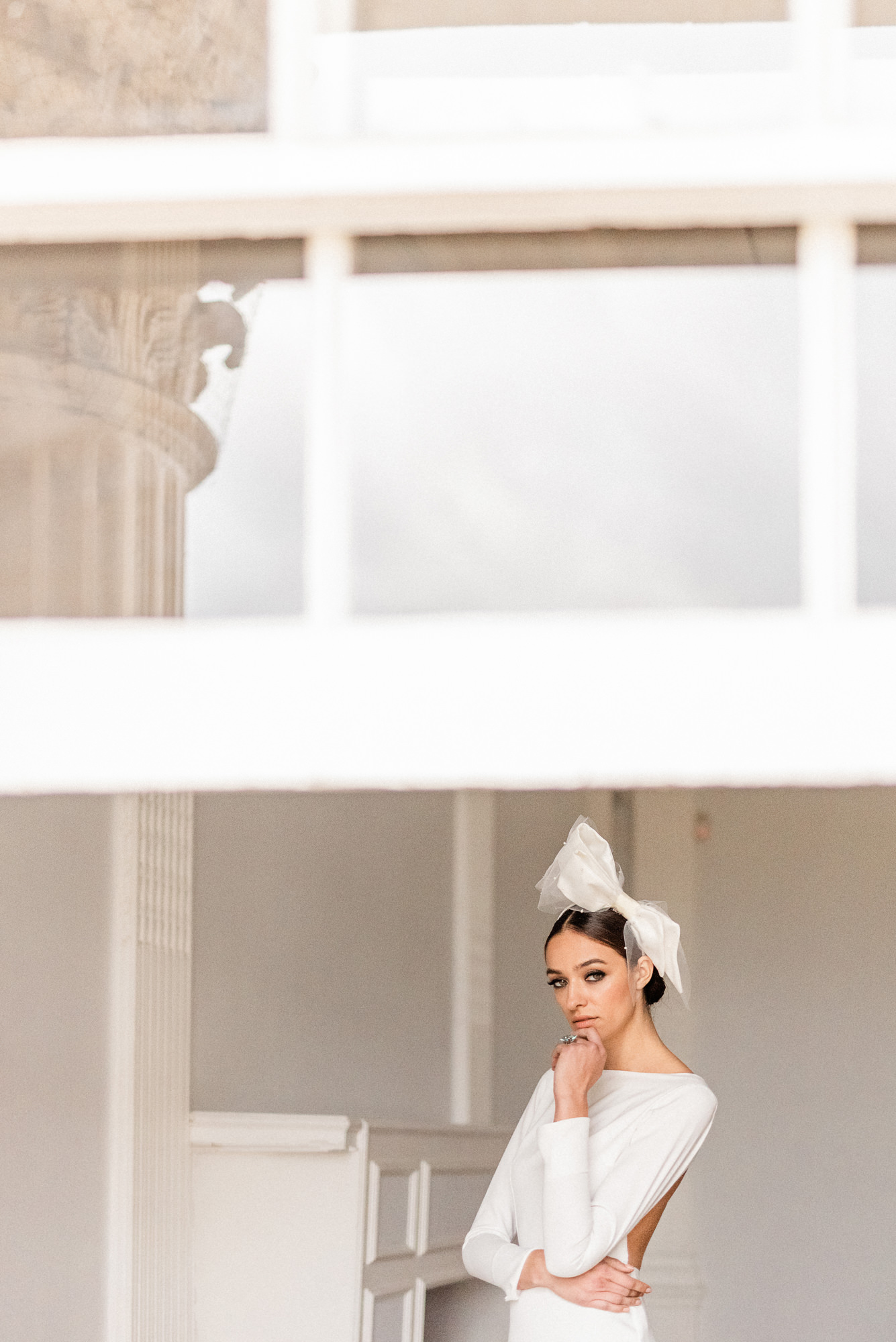 Fashionable bride with large white bow in hair - photo by Gianluca Adovasio Photography