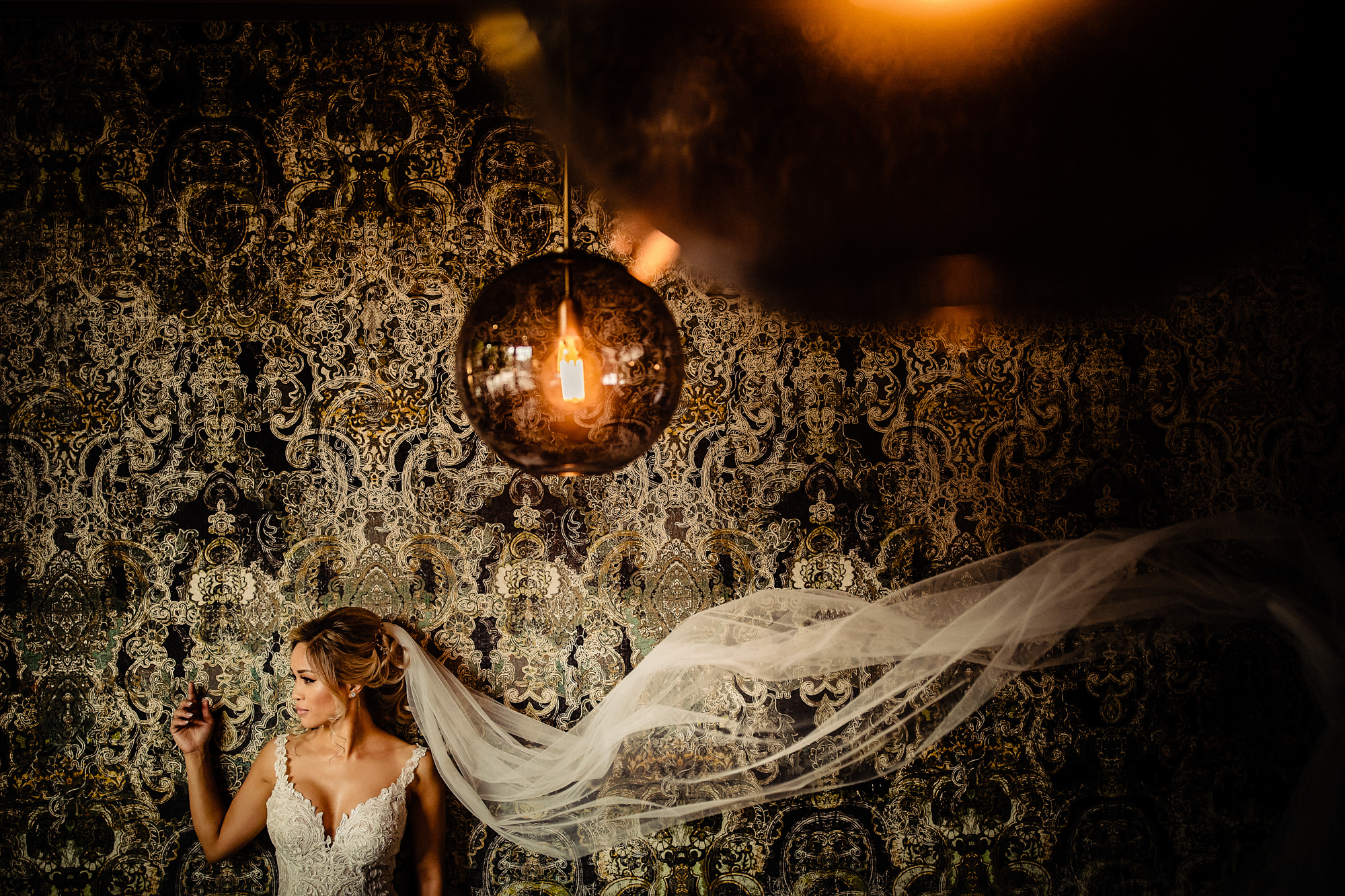 Bride in lace bodice with veil by Eppel Photography