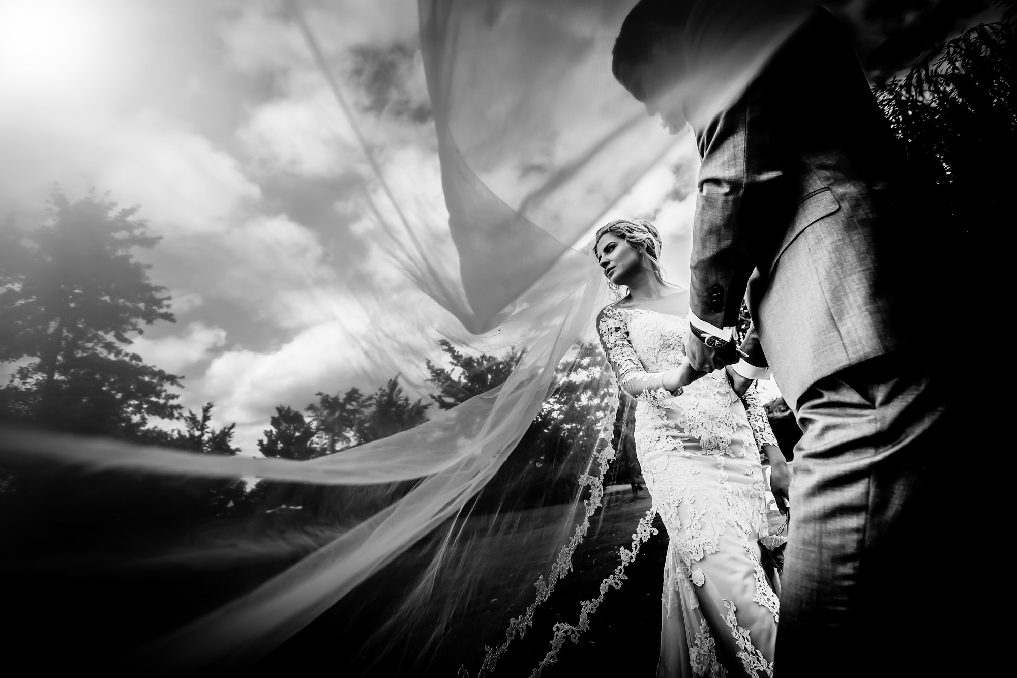 Photo of blonde bride from beneath veil by Eppel Photography