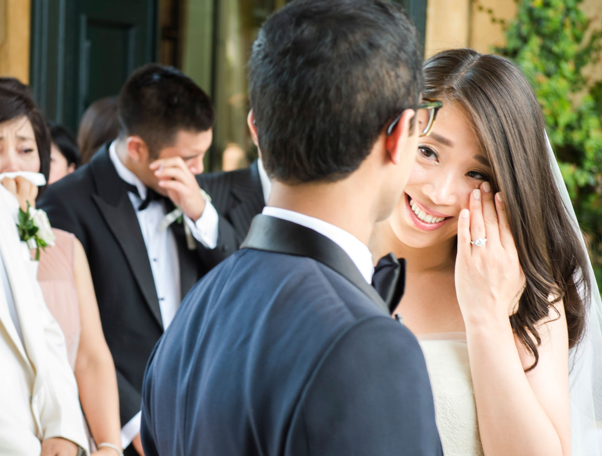 Bride and guests wiping away tears of joy - Studio Impressions Photography