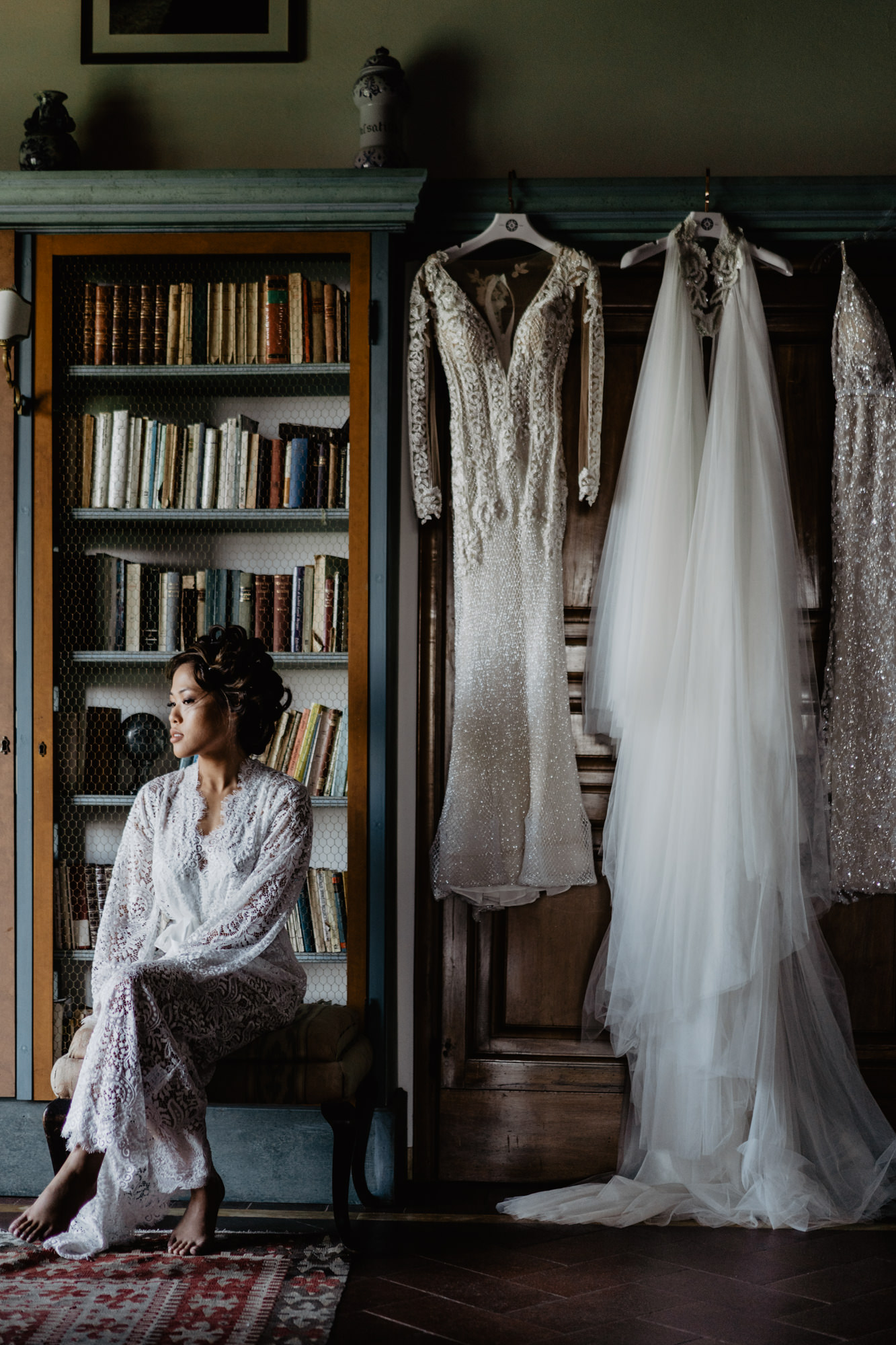 Bride beside couture wedding gowns photo by David Bastianoni