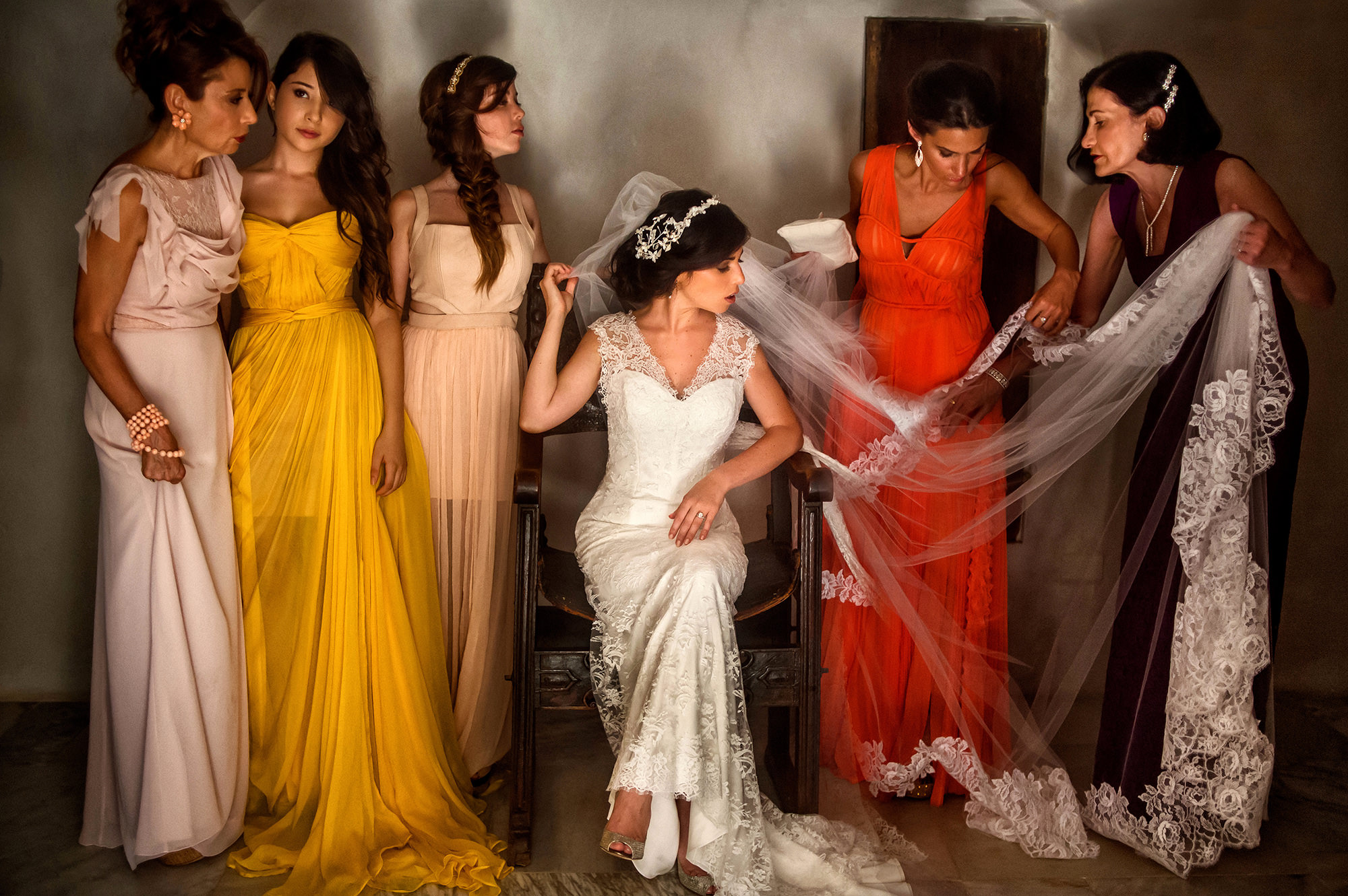 Bridesmaid fixing bride's long lac veil - photo by Davina + Daniel