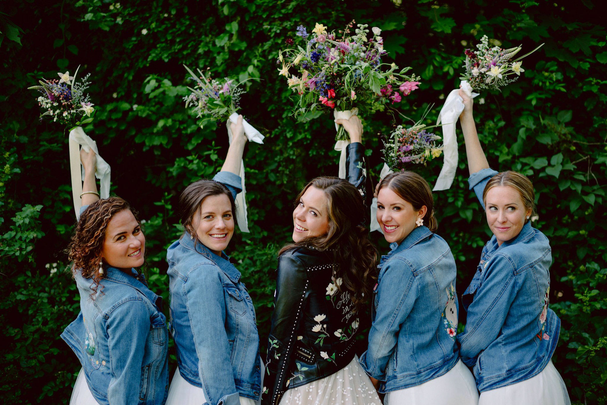 Bridesmaids and bride in cute denim custom jackets, photo by Benj Haisch