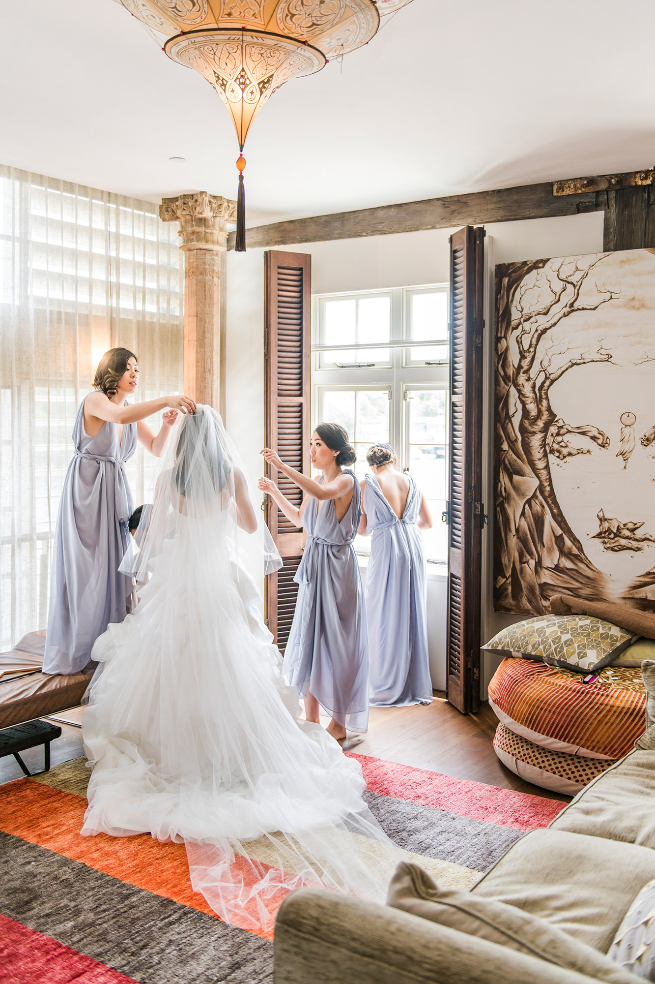 Bridesmaids helping bride get married in Oriental room - Studio Impressions Photography
