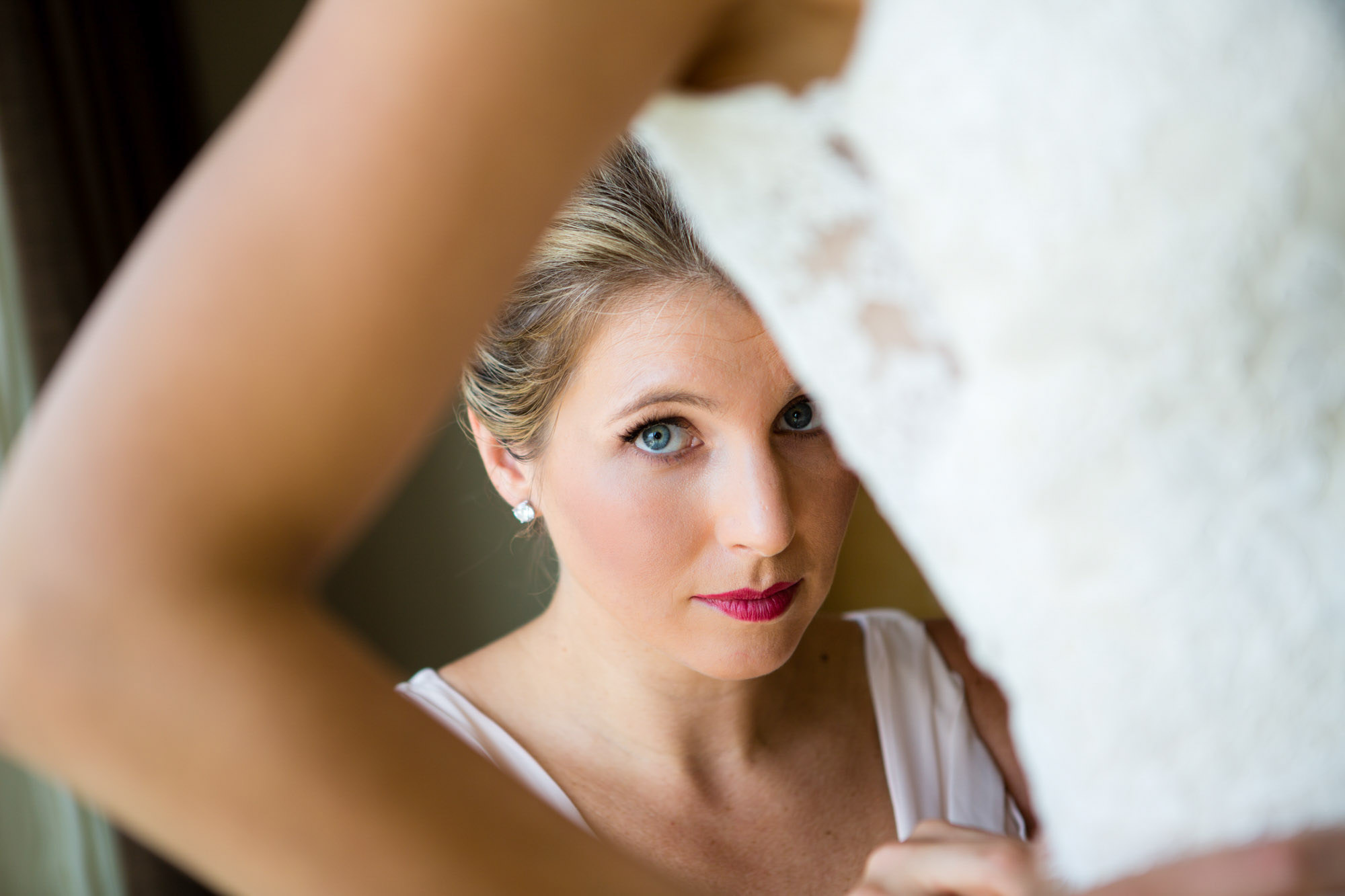 Candid portrait of mom getting bride ready photo by  La Vie