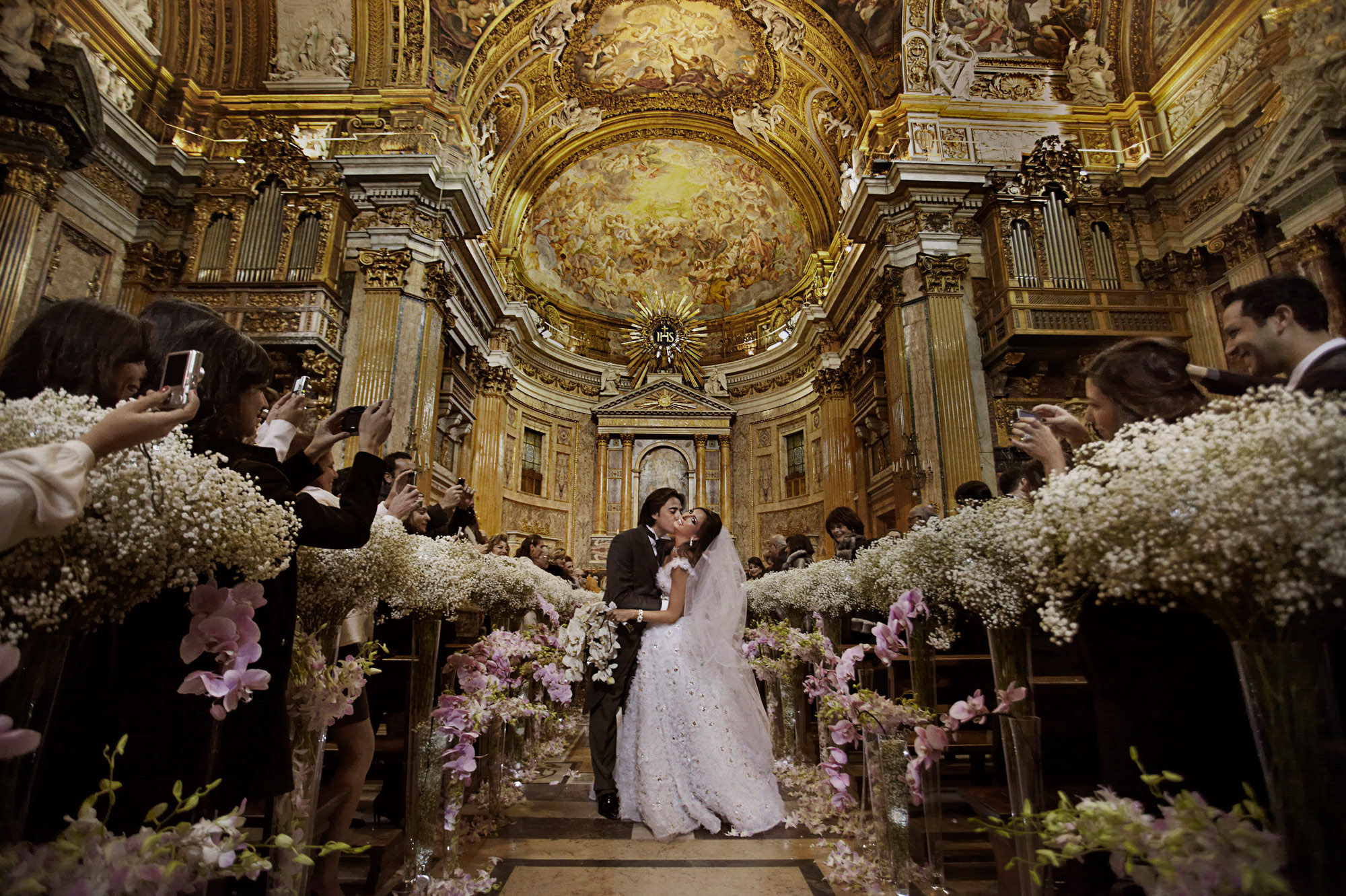 Ceremony kiss in cathedral - photo by Jerry Ghionis