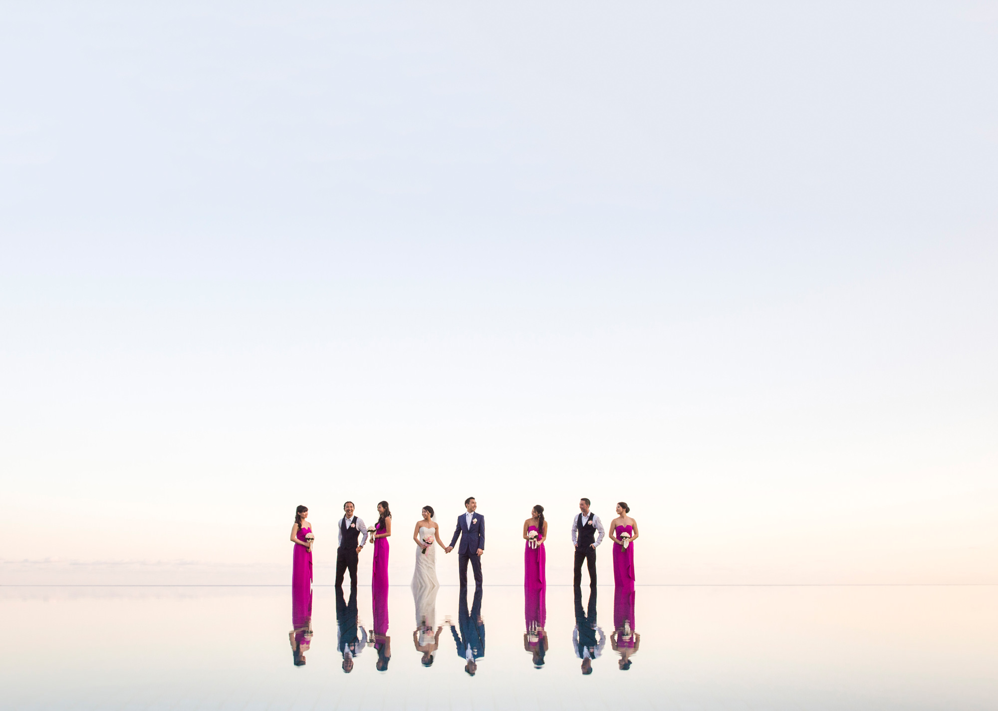 Chic bridal party reflected in infinity pool - best wedding portraits of the decade Studio Impressions Photography