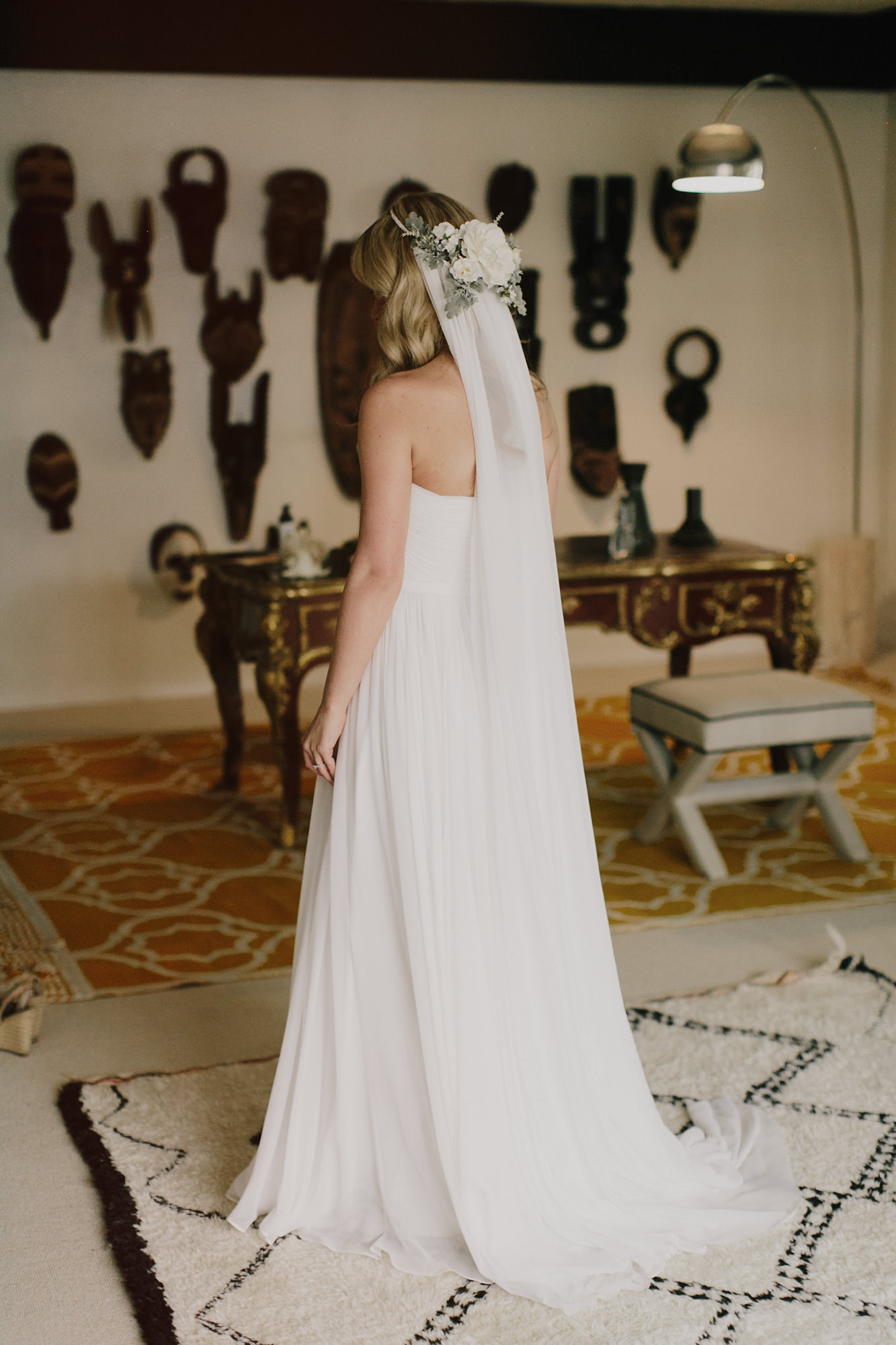 Photo of bride in long veil with white rose crown by James Moes