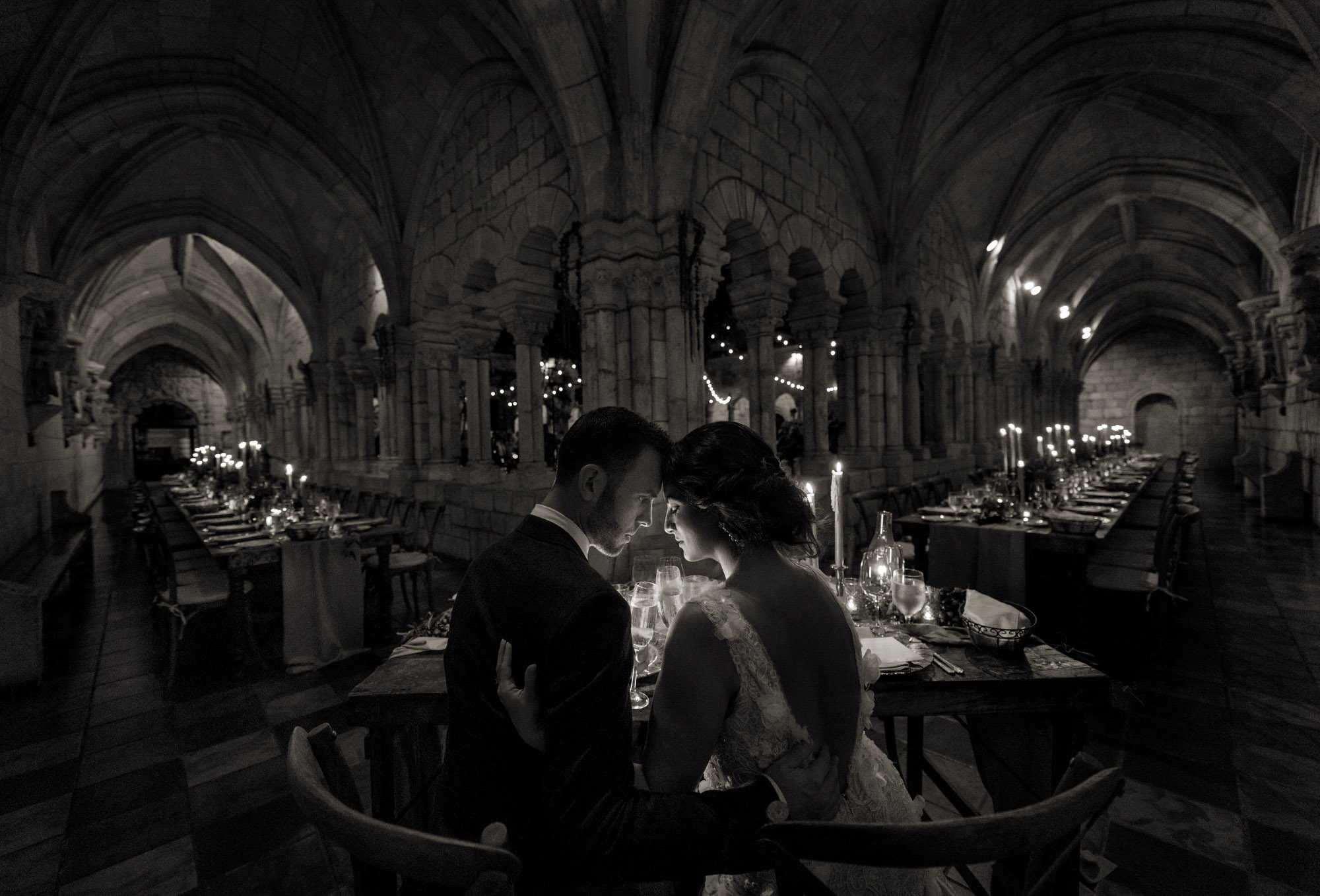 Bride and groom at head table in luxury venue - photo by Jerry Ghionis