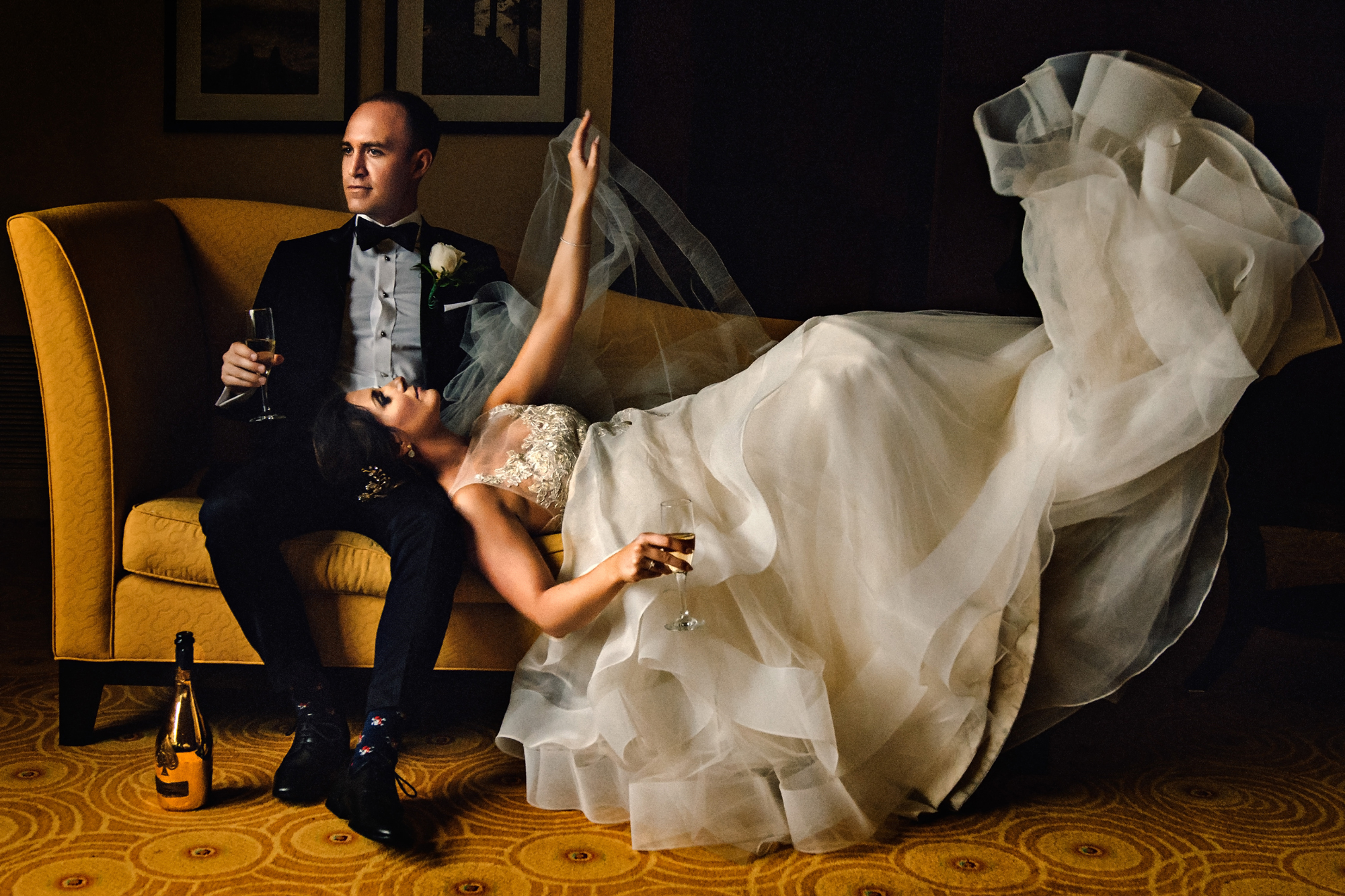 Couple relaxing with champagne - photo by Cooked Photography