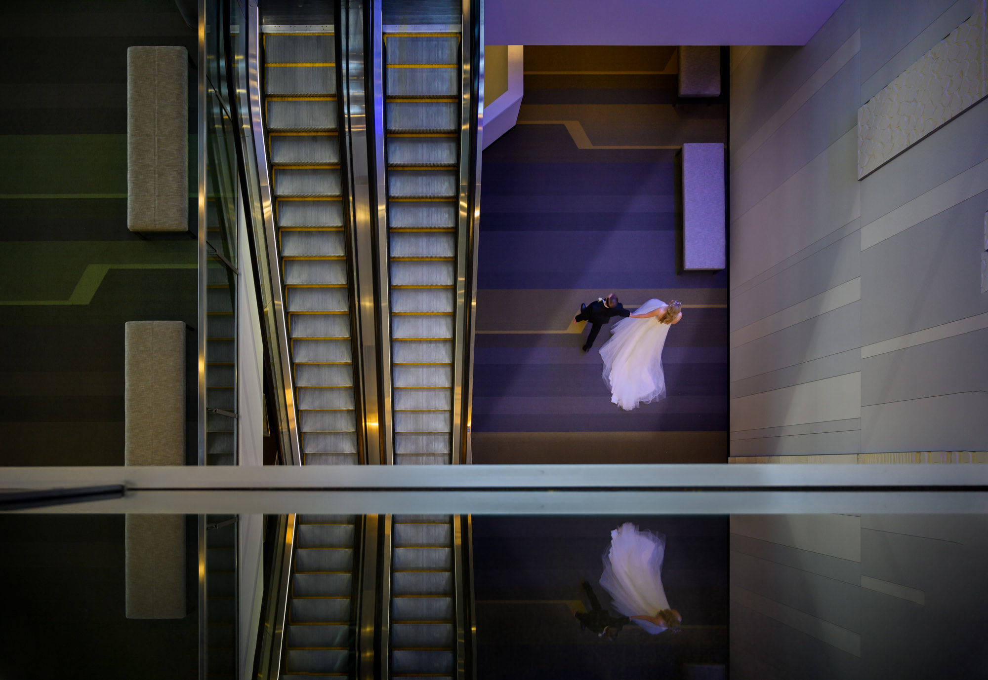 Bride and groom at bottom of elevator - Studio Impressions Photography