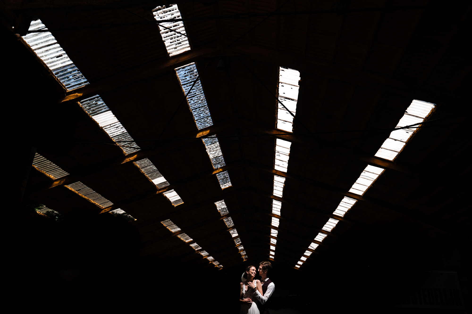 Wedding couple under skylight photo by Yves Schepers
