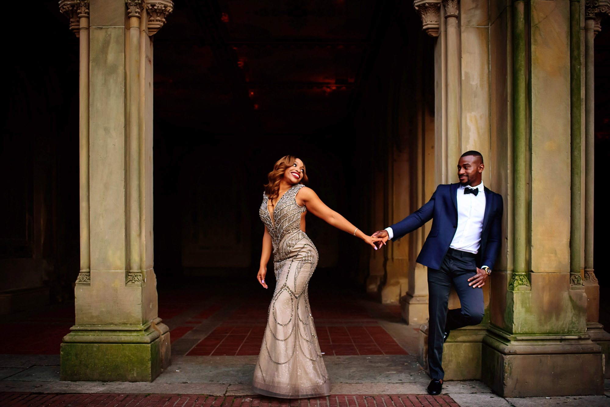 Fashionable bride and groom holding hands - photo by Jide Alakija