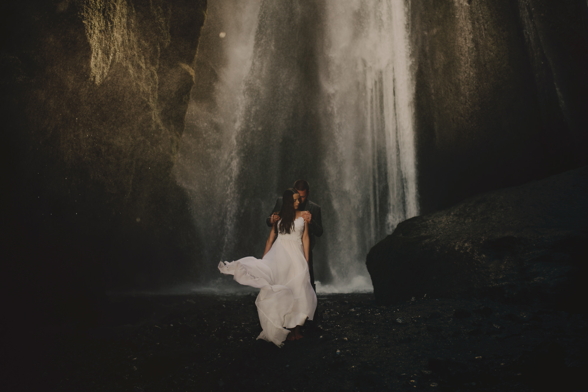 Couple at waterfall - photo by McClintock Photography Agency