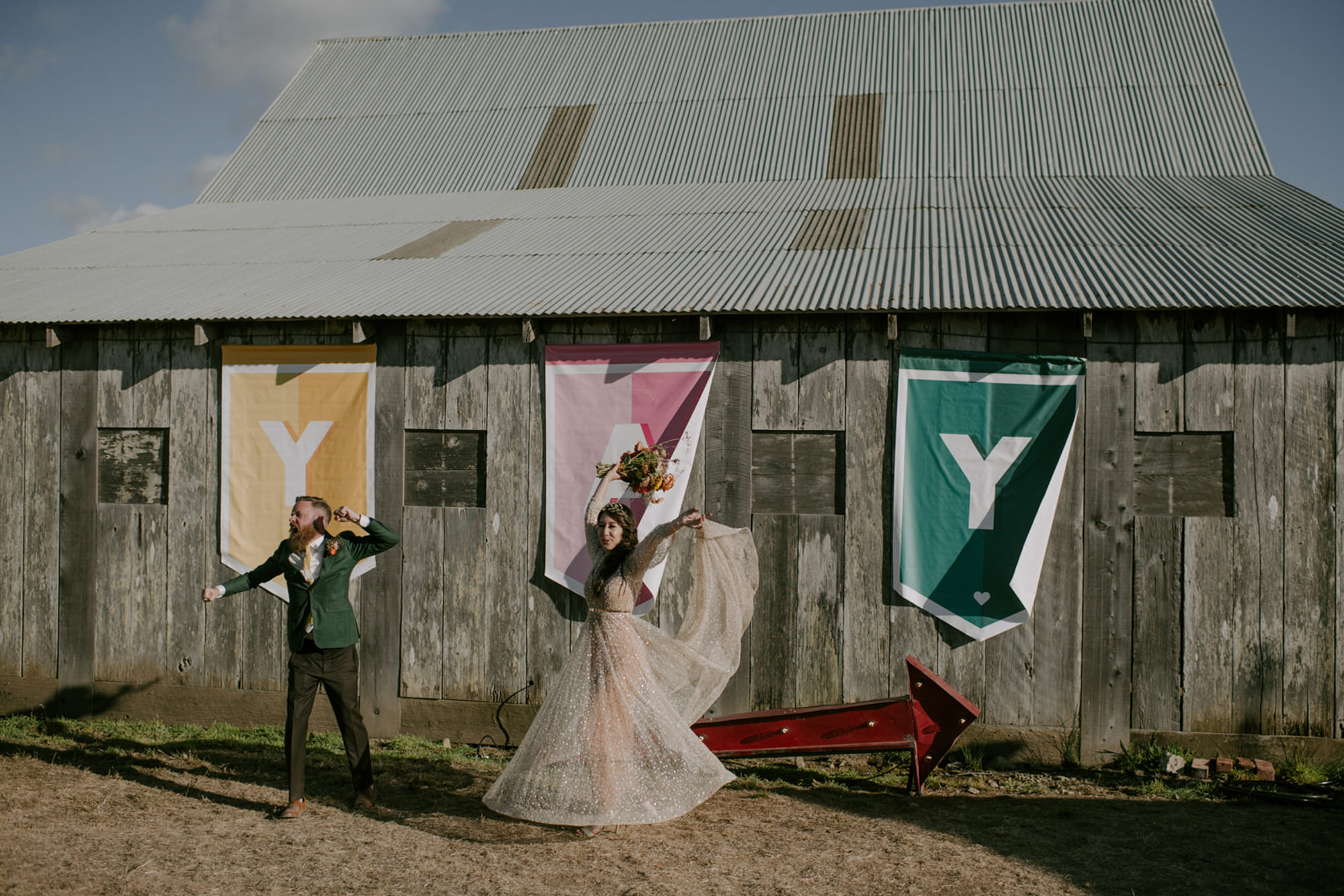 Couple celebrates in front of  YAY banner- photo by Kristen Marie Parker