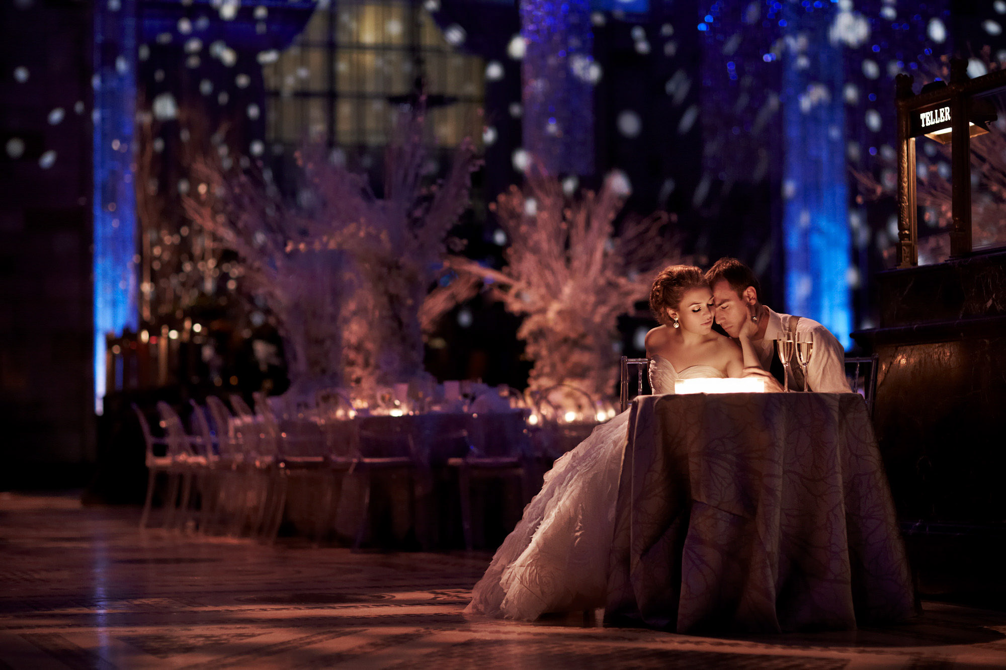 Couple embracing at their luxury table - photo by Jerry Ghionis