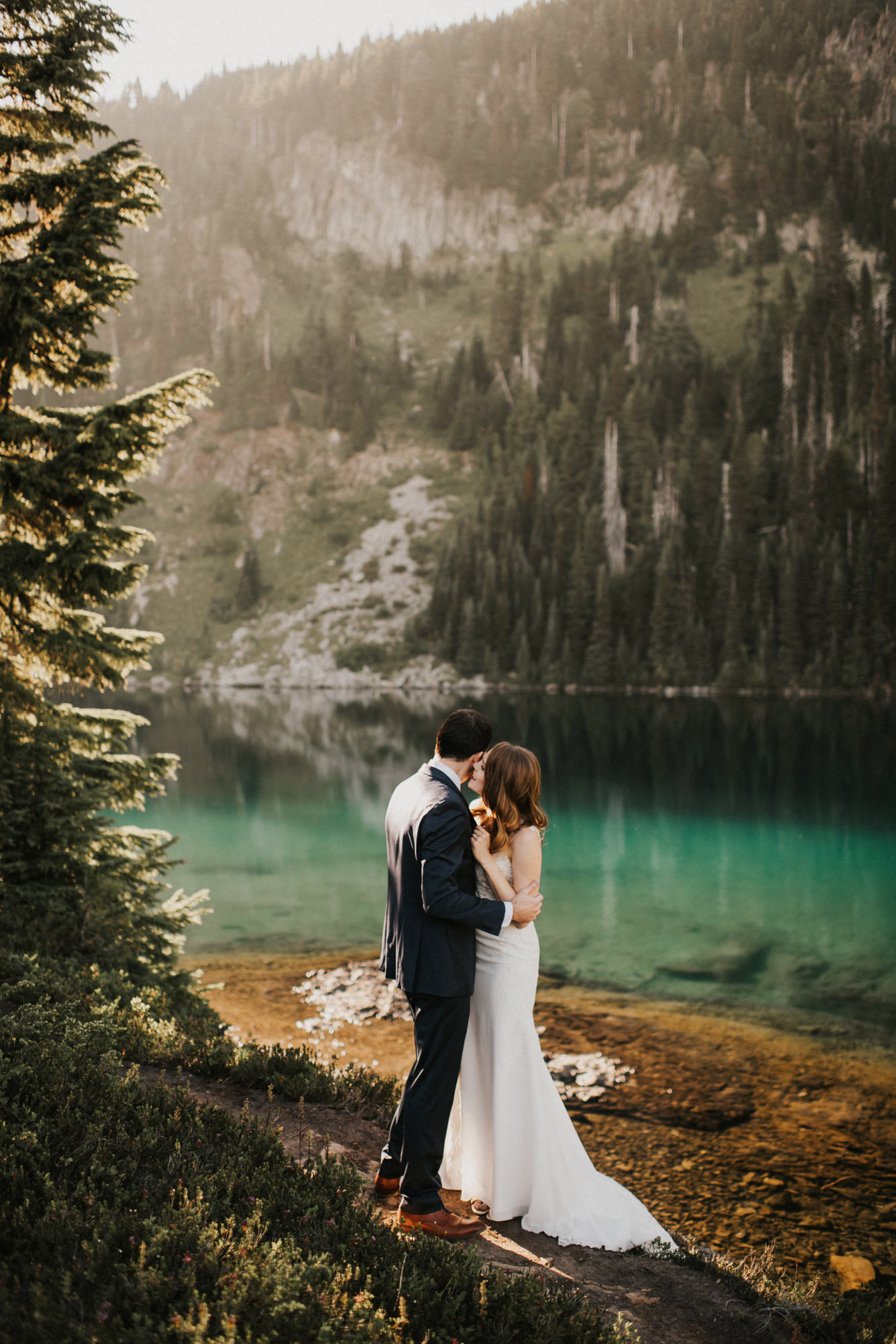 Couple embraces by mountain lake - Nick + Danee