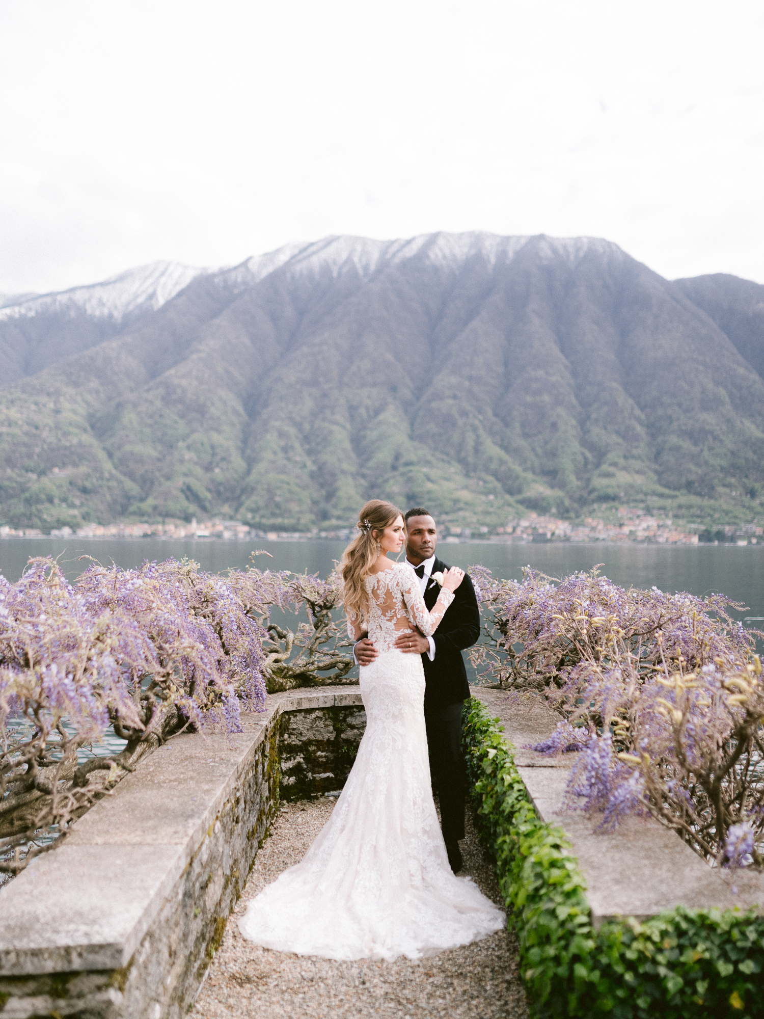 Couple surrounded by wisteria at lakefront - photo by Gianluca Adoviaso Photography