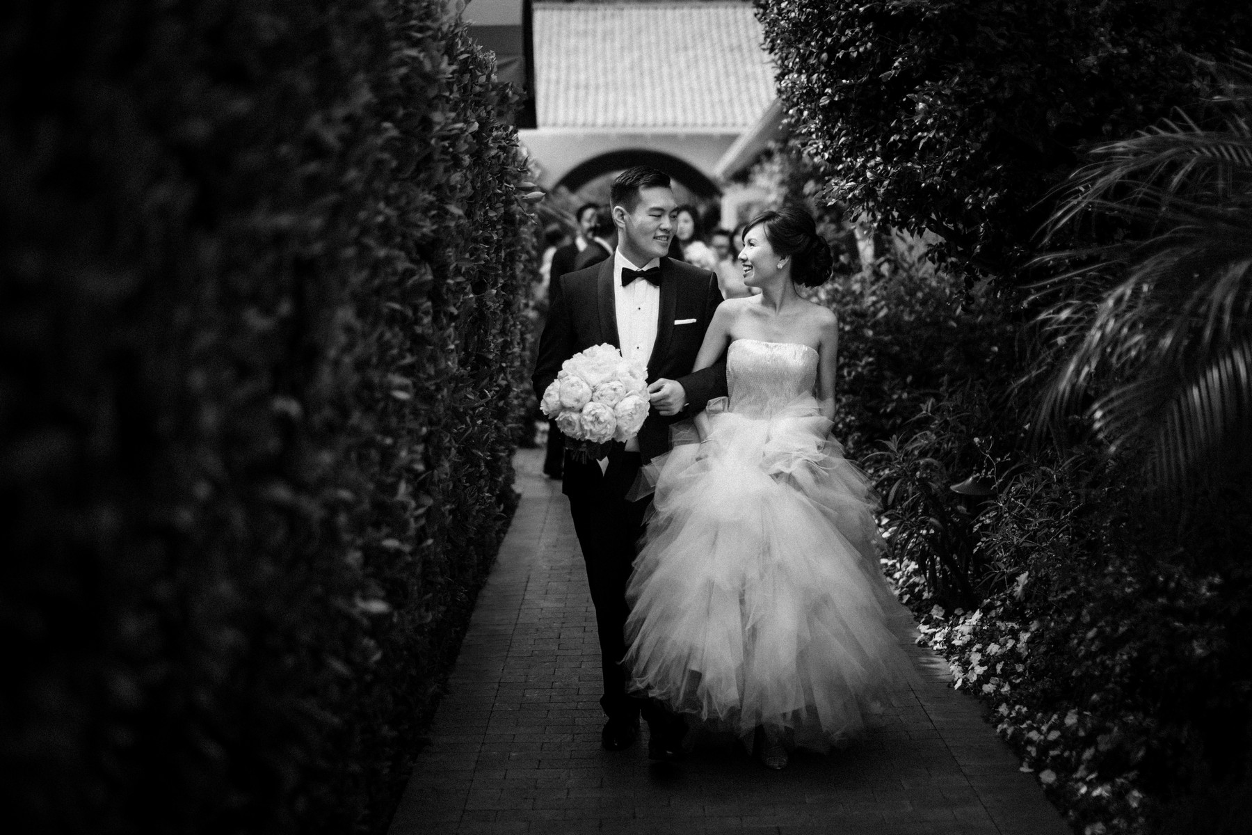 Couple leaving ceremony ahead of guests - John and Joseph Photography